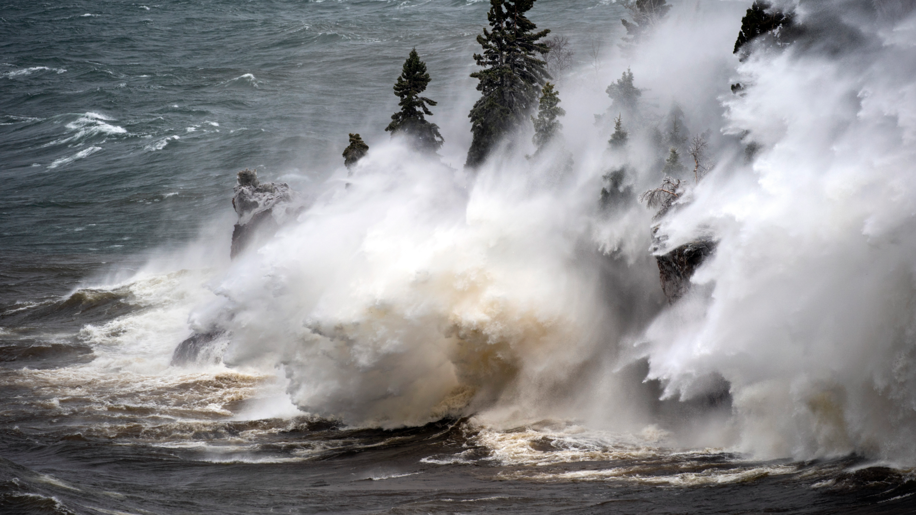 Waves pound the shoreline at Tettegouche State Park Thursday, April 11, 2019 at Silver Bay, Minn. Wind gusts were up to 50 milers per hour.  (Brian Peterson/Star Tribune via AP)