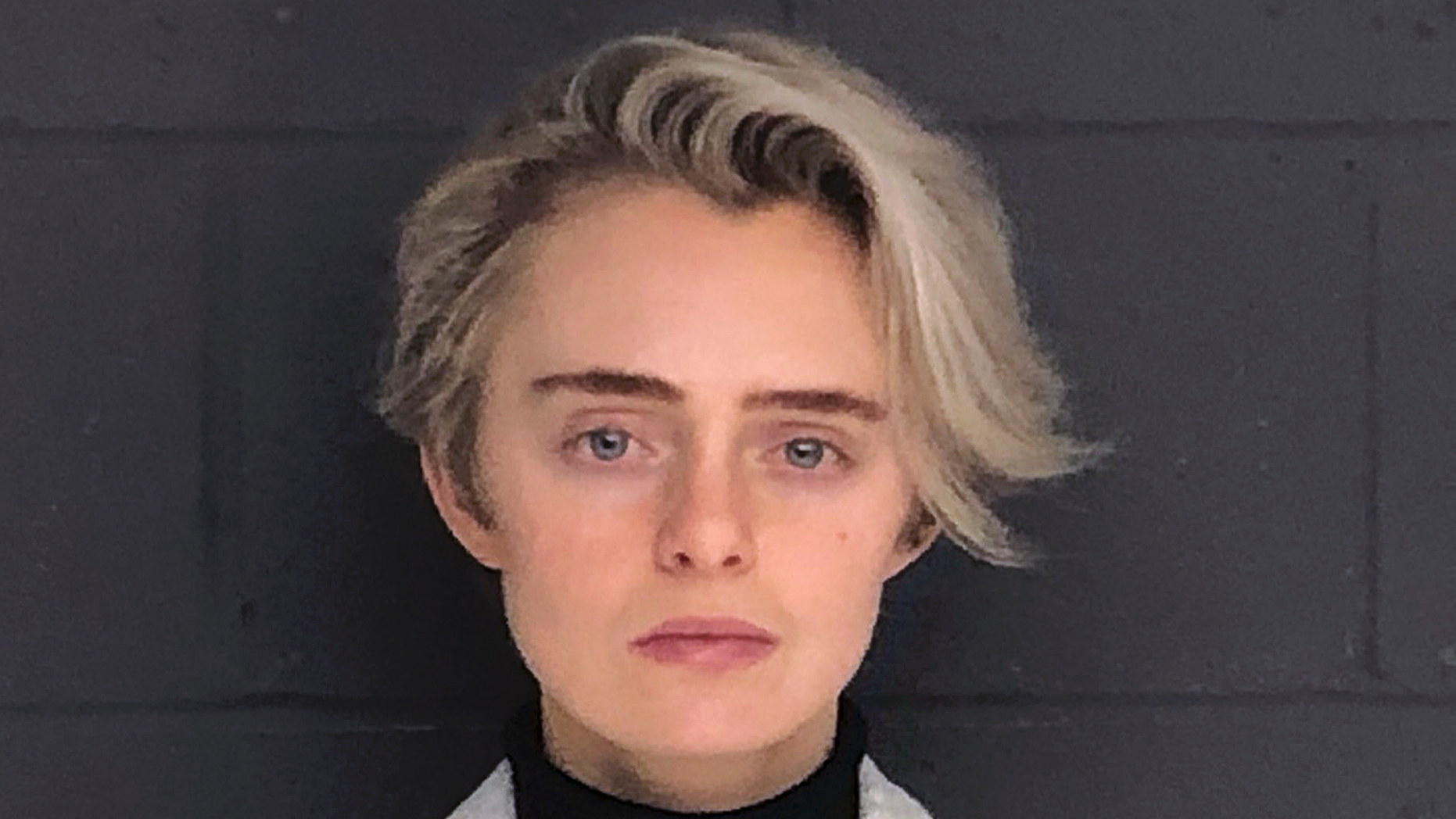 "FILE - This Monday, Feb. 11, 2019, booking photo released by the Bristol County Sheriff's Office shows Michelle Carter, ordered to start serving a 15-month jail sentence for her involuntary manslaughter conviction for sending a barrage of text messages urging boyfriend Conrad Roy III to kill himself. Roy took his own life in Fairhaven, Mass., in July 2014. An attorney for Lynn Roy, the boy's mother, said Tuesday, April 9, that her wrongful death suit against Carter had been ""resolved."" (Bristol County Sheriff's Office via AP, File)"