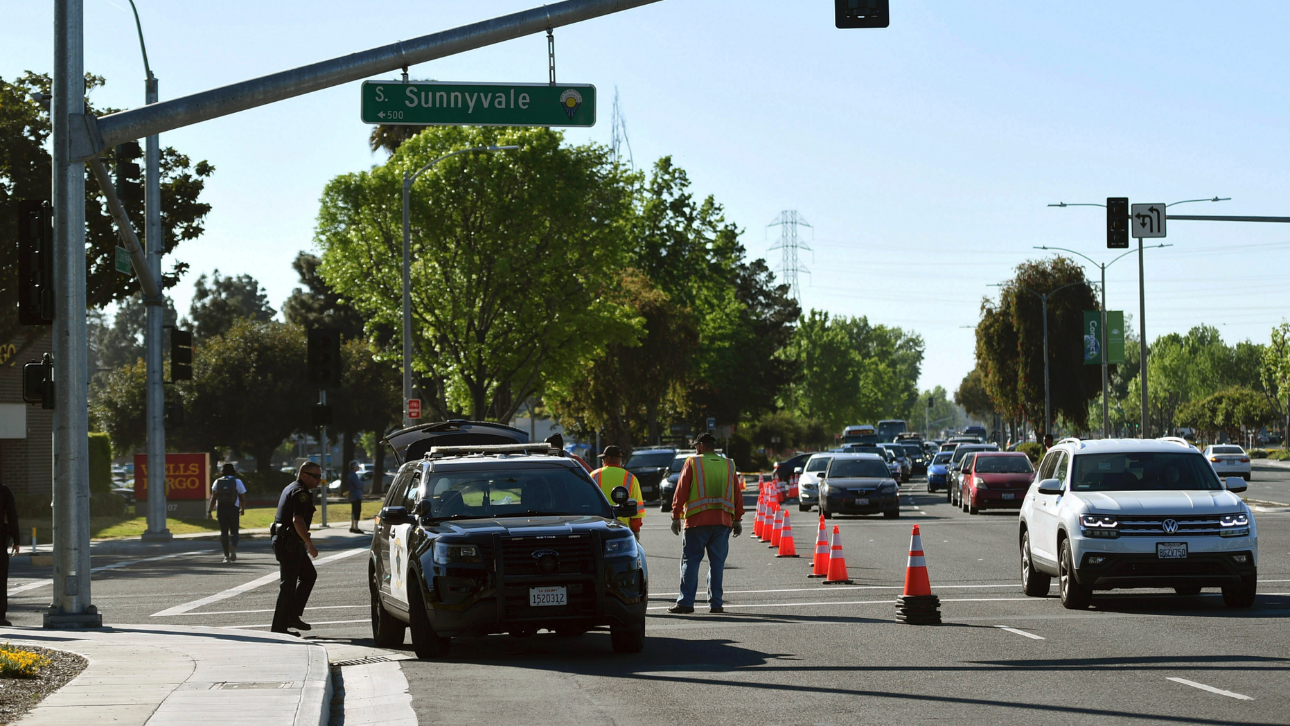 Police investigate the scene of car crash at the intersection of El Camino Real and Sunnyvale Road in Sunnyvale, Calif., on Wednesday, April 24, 2019. Investigators are working to determine the cause of the crash in Northern California that injured several pedestrians on Tuesday evening. Authorities say the driver of the car was taken into custody after he appeared to deliberately plow into the group. (AP Photo/Cody Glenn)