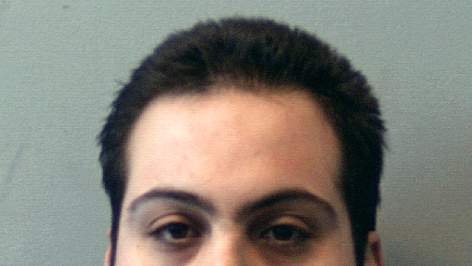 FILE - This booking photo released Thursday, March 1, 2018, by the Beverly Police Department shows Daniel Frisiello, of Beverly, Mass., accused of mailing five envelopes containing a white powder. Prosecutors are seeking three years in prison for Frisiello who admitted to sending threatening letters filled with white powder to President Donald Trump's sons and others. Frisiello is set to be sentenced Friday, April 19, 2019, in Boston federal court. (Beverly Police Department via AP, File)