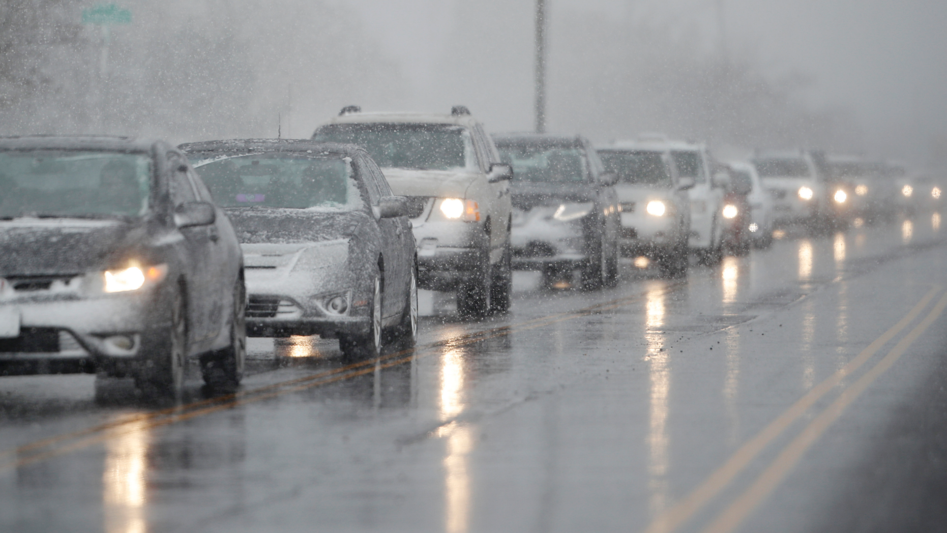 Traffic backs up along 56th Avenue as a spring storm rolls in before the evening rush hour Wednesday, April 10, 2019, in Denver. Blizzard warnings have been issued for the northern half of Colorado's heavily populated Front Range region, including Denver, as well as the state's northeastern plains through midday Thursday. (AP Photo/David Zalubowski)