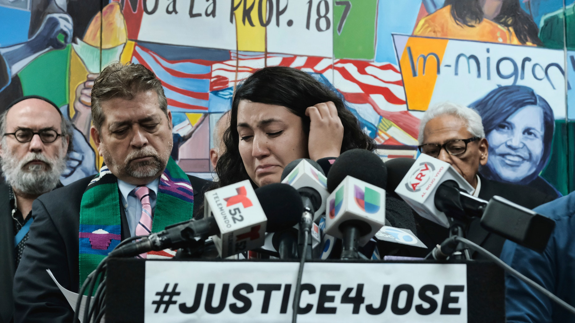 Melissa Castro tries to force back tears as she talks about her husband, Jose Luis Ibarra Bucio, while joined by local religious leaders during a news conference at the offices of the Coalition for Humane Immigrant Rights of Los Angeles (CHIRLA), Wednesday, April 10, 2019, in Los Angeles. The family of the 27-year-old man who died after a short stint in a California immigration detention facility demanded answers Wednesday about what happened to him and the timing of his release. Melissa Castro said her husband, was released as his health deteriorated from a brain hemorrhage and while he was in a coma from which he never awoke. (AP Photo/Richard Vog)el