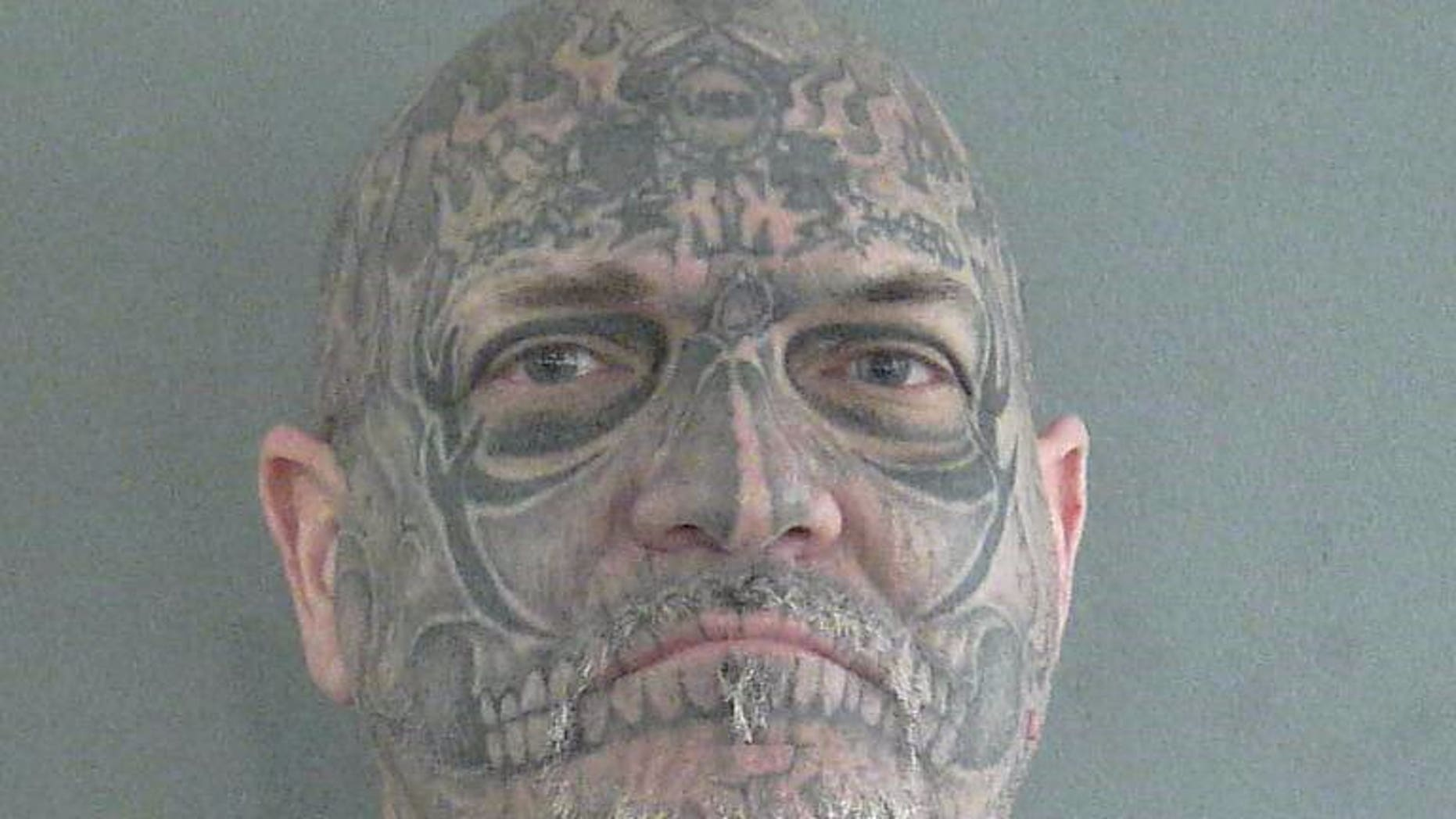 Man with skull-face tattoo arrested in 2001 Florida slaying