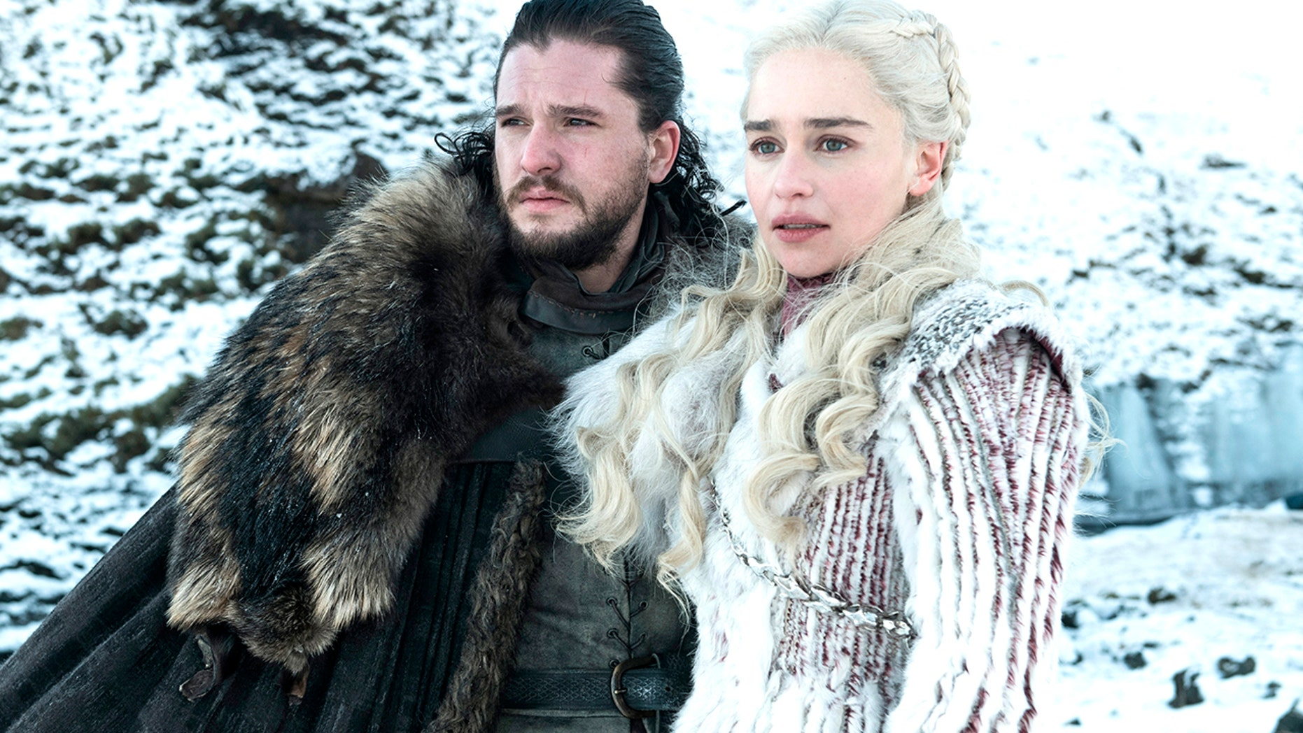 "This photo released by HBO shows Kit Harington as Jon Snow, left, and Emilia Clarke as Daenerys Targaryen in a scene from ""Game of Thrones."""