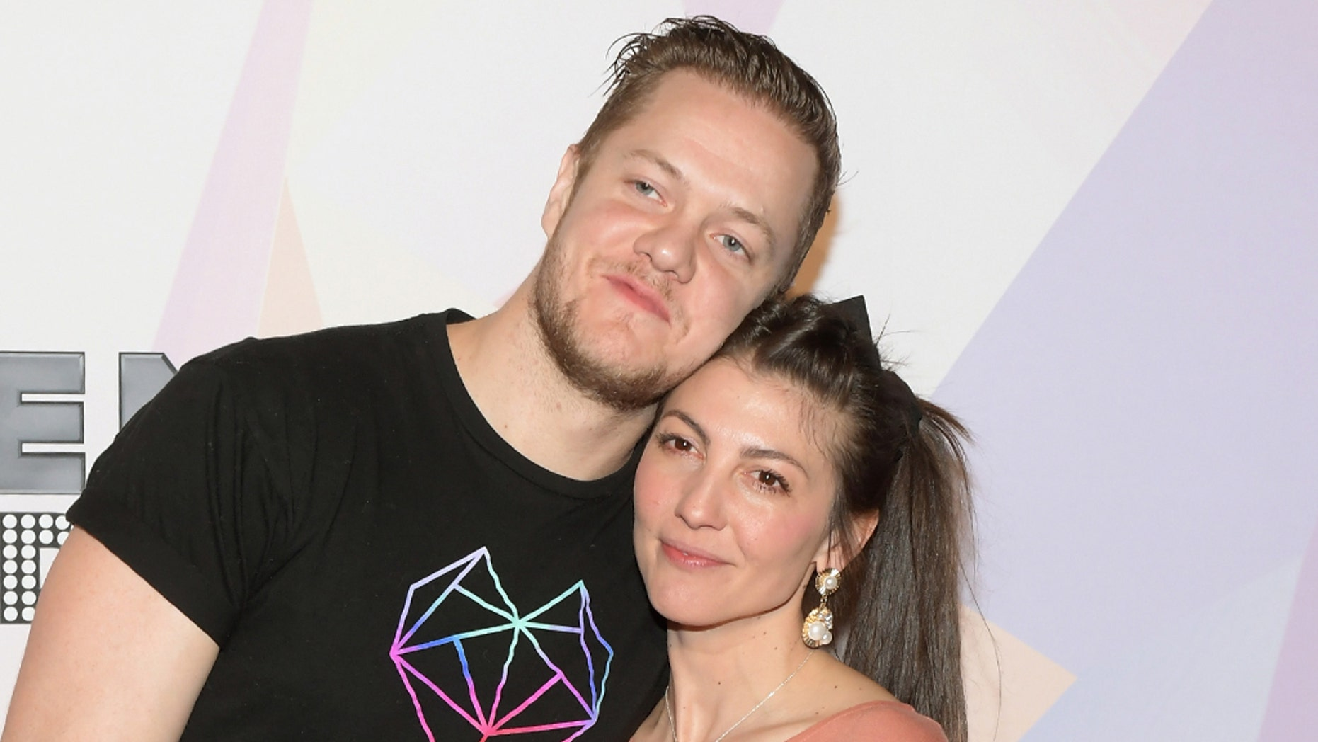 Imagine Dragons frontman Dan Reynolds (L) and his wife and singer Aja Volkman.