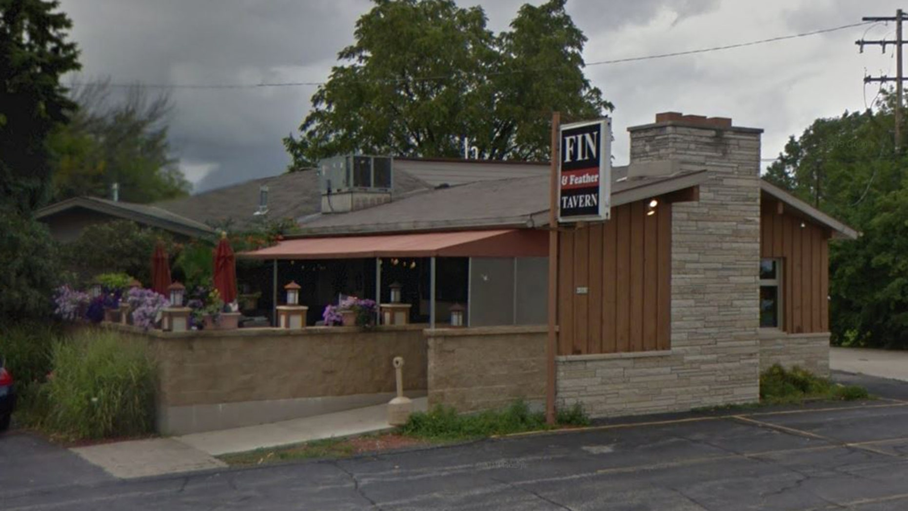 According to police, the suspect had been disruptive inside the Fin n' Feather before he tried to bring his dog inside