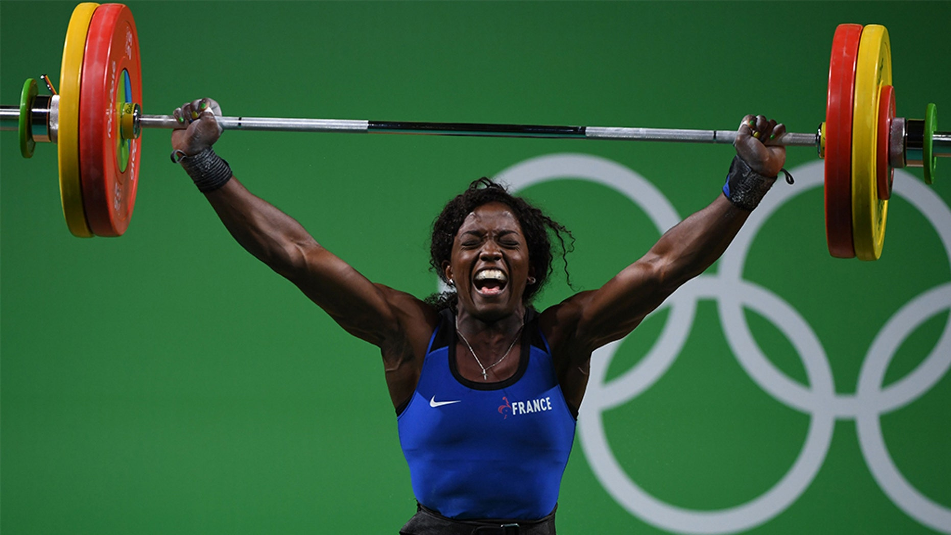 France's Gaelle Verlaine Nayo Ketchanke reacts during a women's weightlifting 75kg eventuality during a Rio 2016 Olympics Games in Rio de Janeiro on Aug 12, 2016.