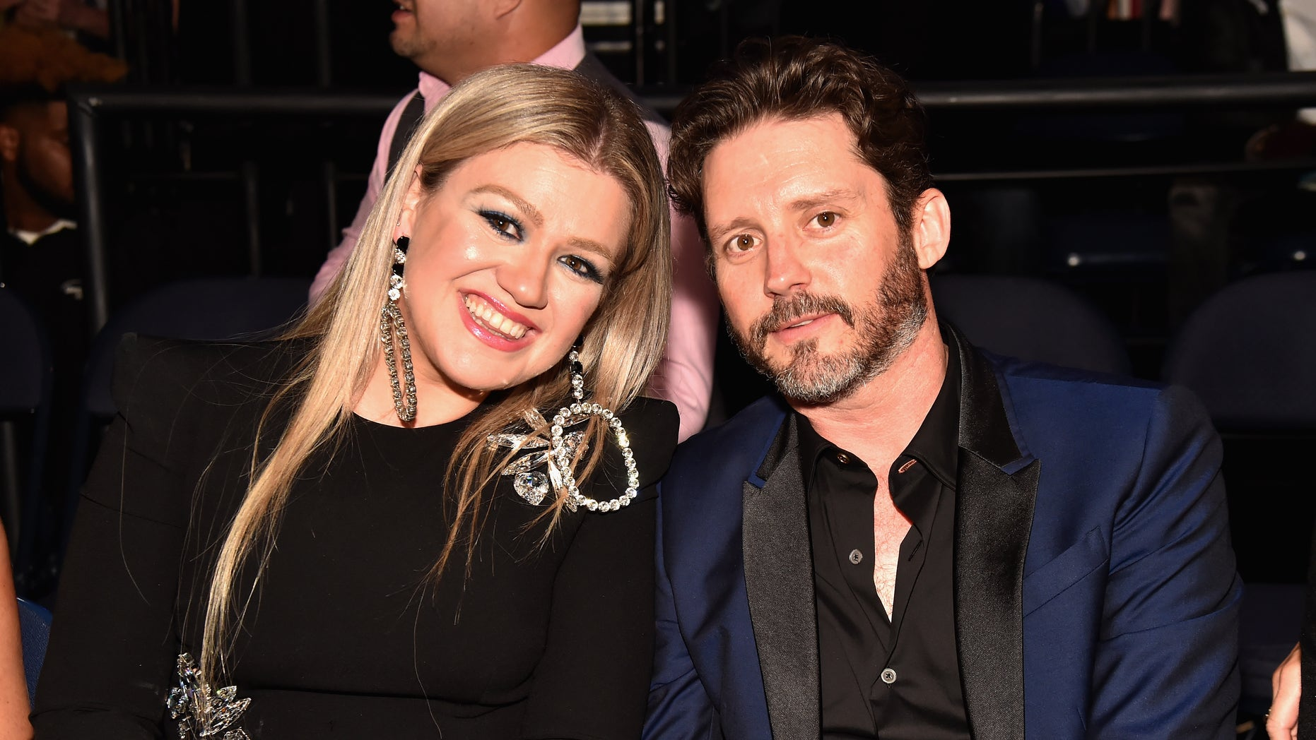 Kelly Clarkson and Brandon Blackstock appeared on stage together at the final performance of her tour.