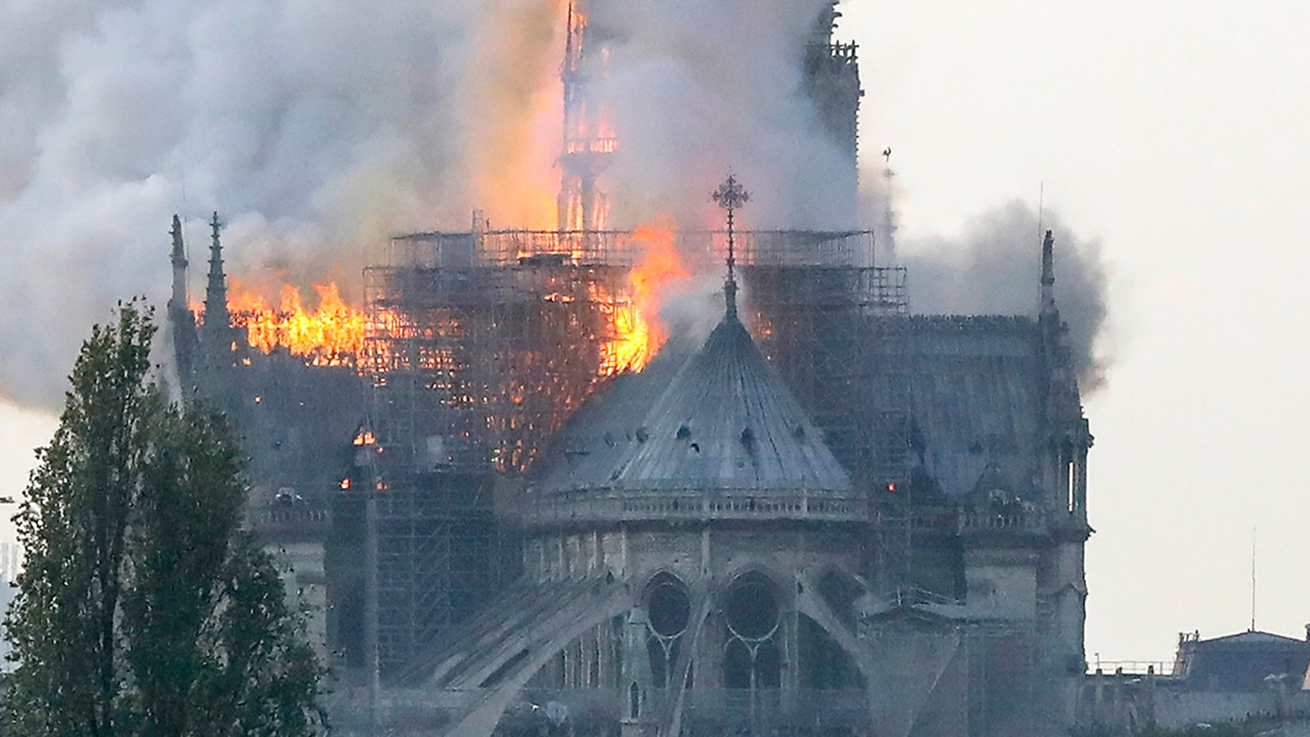 Smokes ascends as flames rise during a fire at the landmark Notre-Dame Cathedral in central Paris on April 15, 2019 afternoon.
