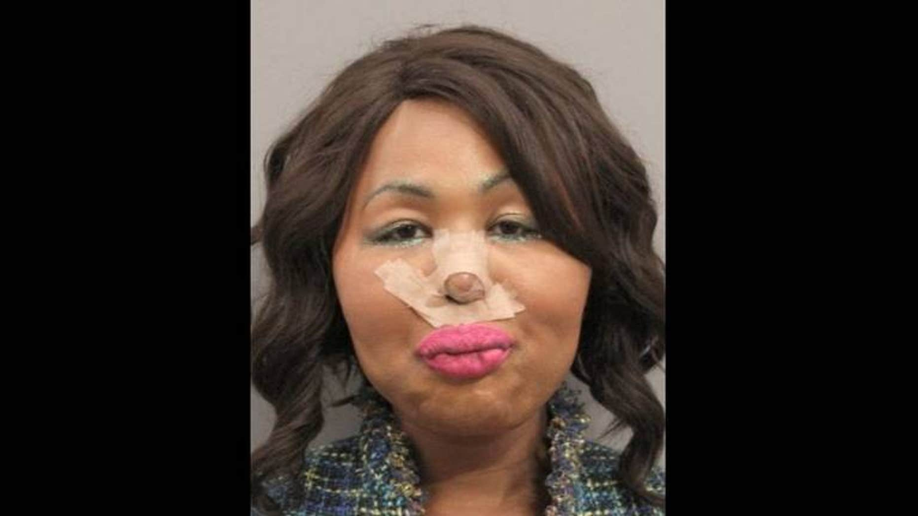 """Jimmy Maurice Lewis II, known as """"Iconic Facce,"""" allegedly robbed a bank to pay for her plastic surgery. (Gulfport Police Department)"""