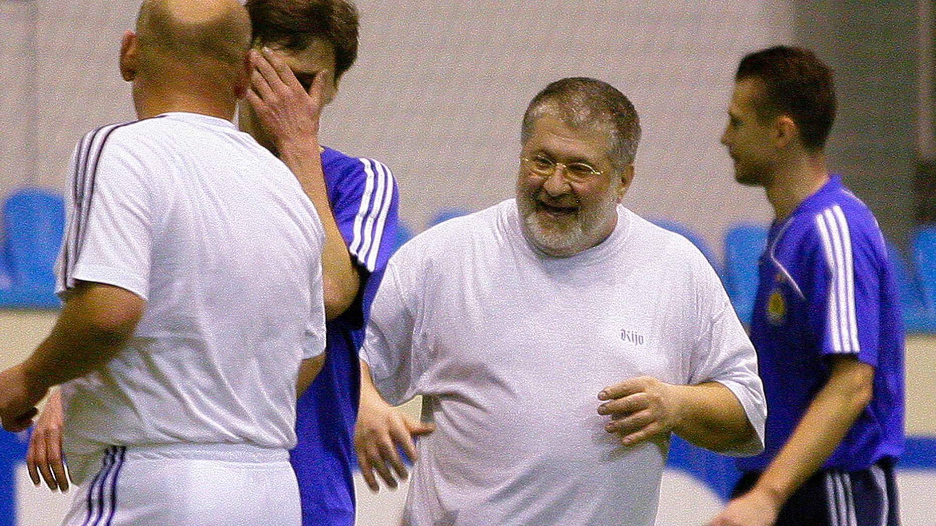 In this photo taken in Feb. 26, 2010, Ukrainian a self-exiled billionaire businessman Ihor Kolomoyskyi, center, plays soccer in Kiev, Ukraine. (AP Photo/Andriy Lukatsky, File)