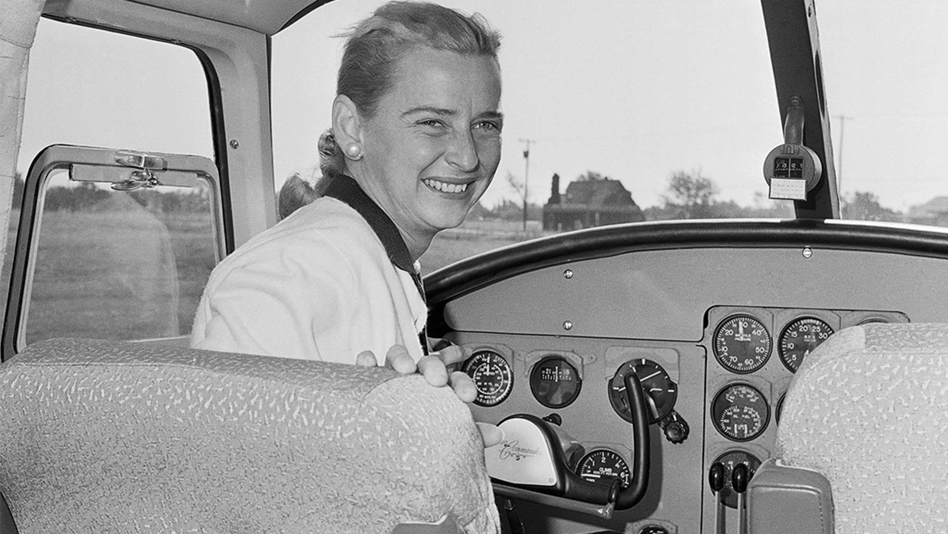 In this 14 October 1960 photograph, Jerrie Cobb sits in the cockpit of a twin-engined Aero Commander aircraft, as the advertising and sales promotion manager for the aircraft manufacturing company in Oklahoma City. (AP Photo)