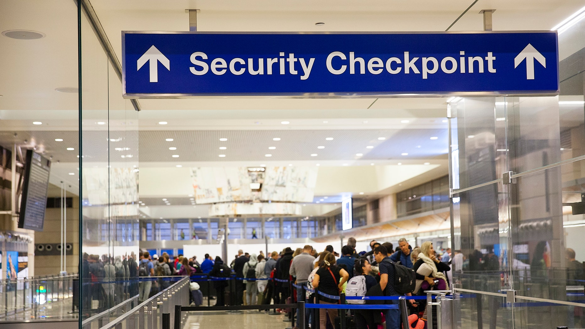 Los Angeles, California, USA-December 2017: Airport Sign during a opening of a confidence checkpoint in LAX airfield with People watchful in line.