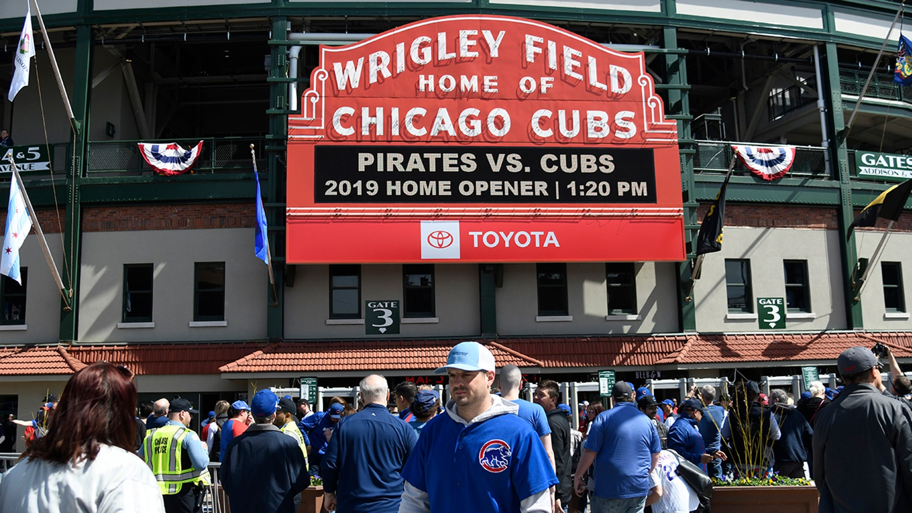 Fans walk around the ballpark before the Chicago Cubs home opening baseball game against the Pittsburgh Pirates, Monday, April 8, 2019, in Chicago.