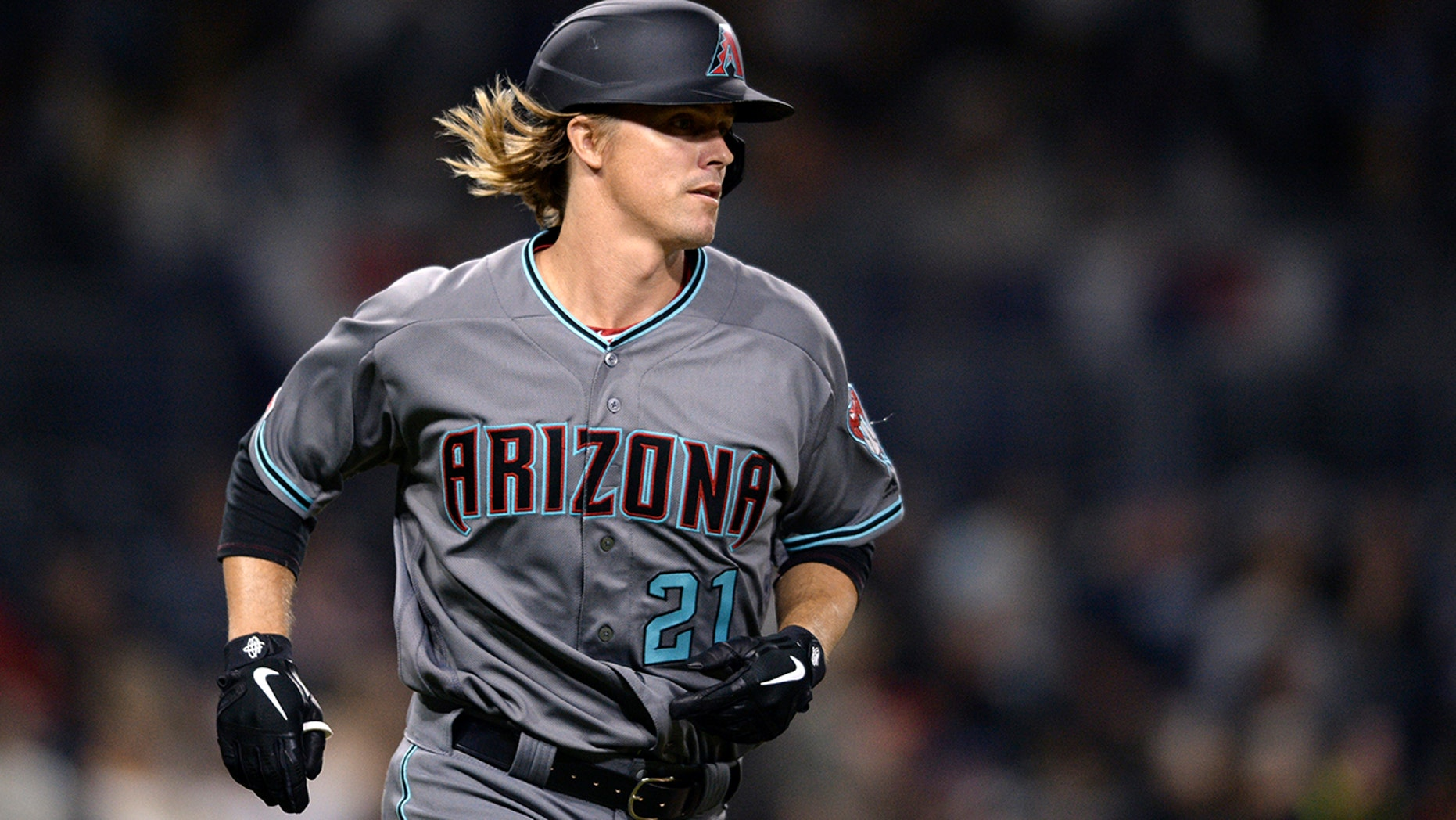 Arizona Diamondbacks' Zack Greinke runs the bases after hitting a home run during the sixth inning of a baseball game against the San Diego Padres, Tuesday, April 2, 2019, in San Diego.