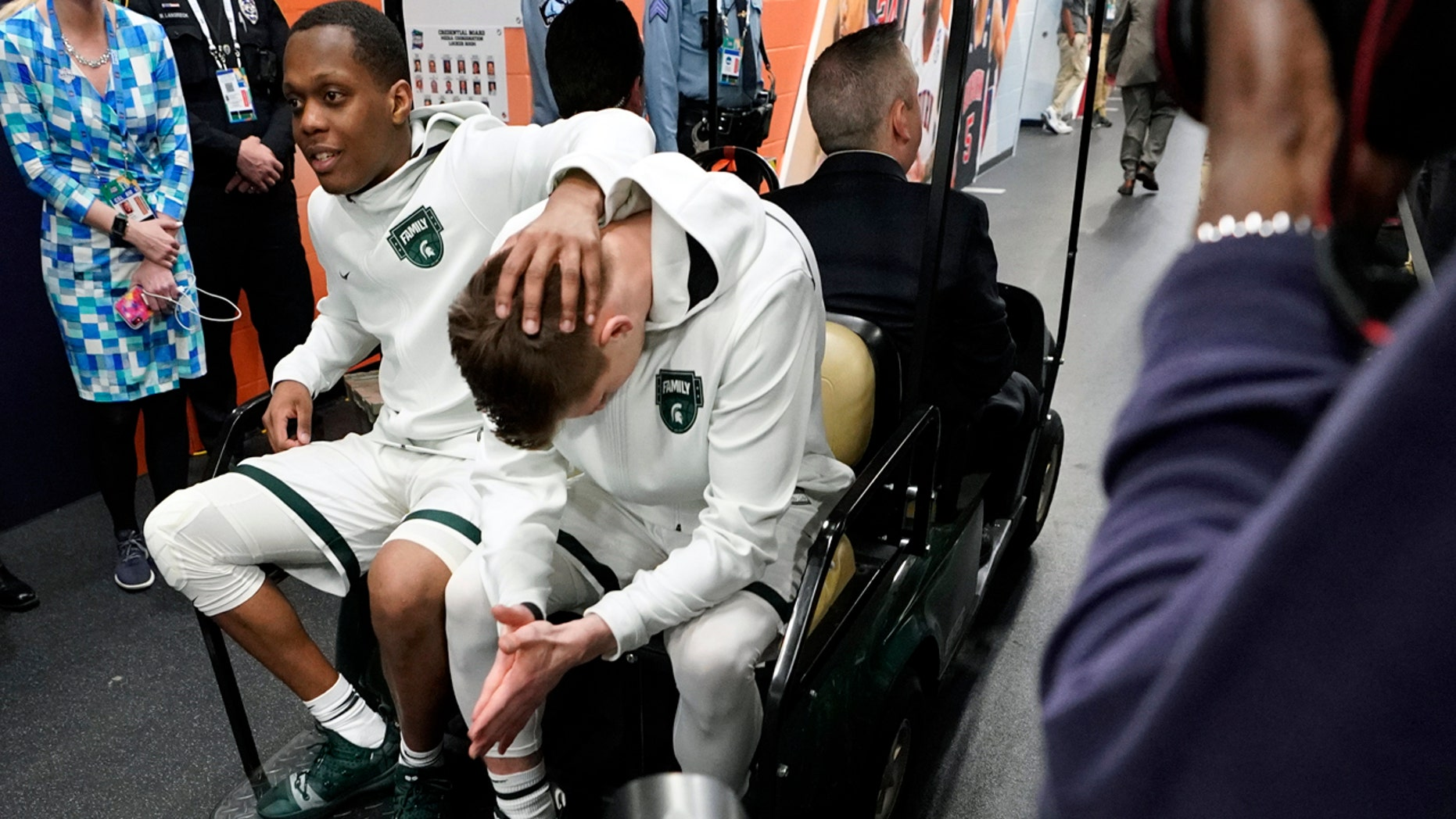 Michigan State's Cassius Winston, left, and Matt McQuaid react after the team's 61-51 loss to Texas Tech. (AP Photo/David J. Phillip)