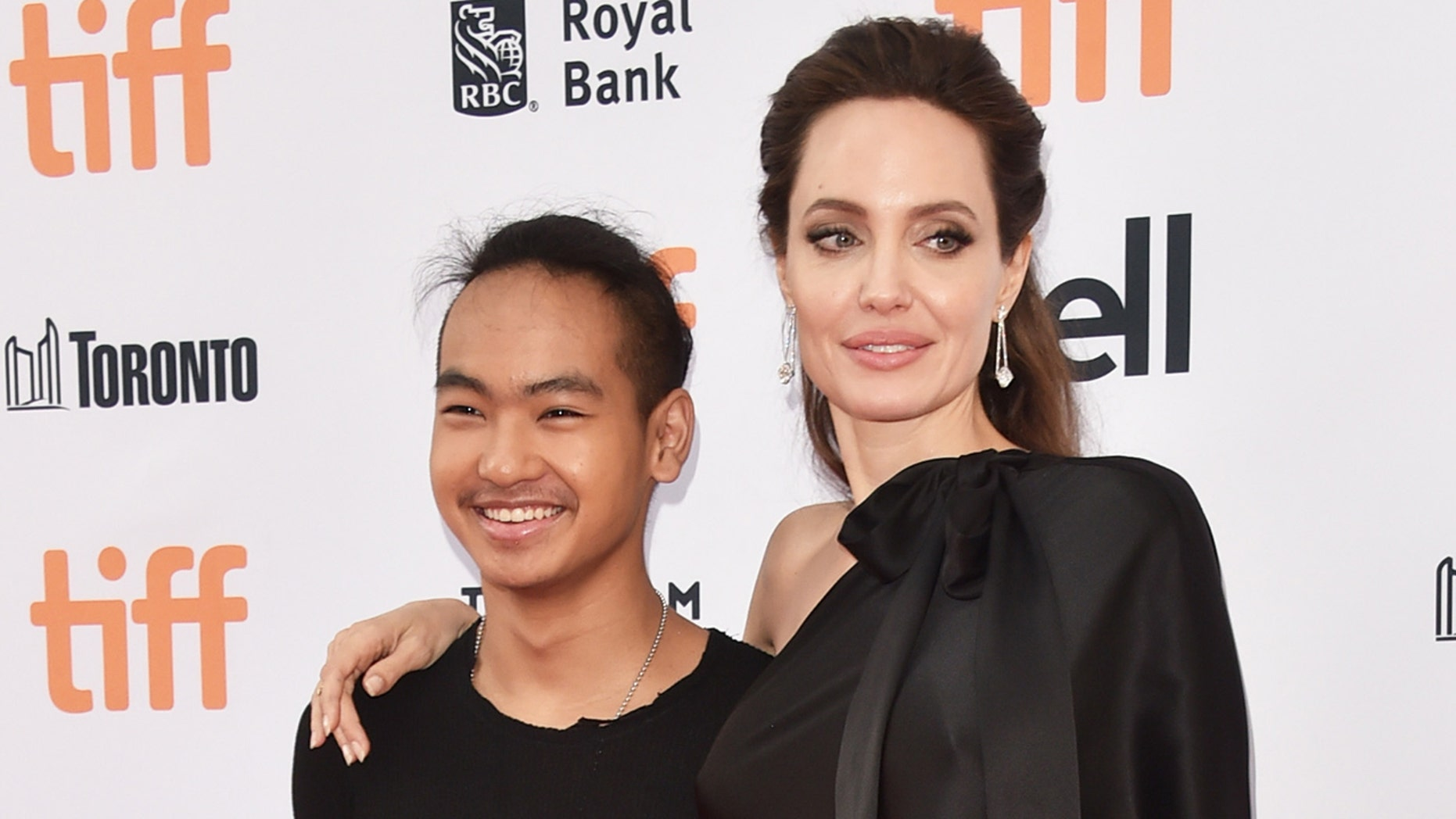 Angelina Jolie and her son Maddox Jolie-Pitt (L).