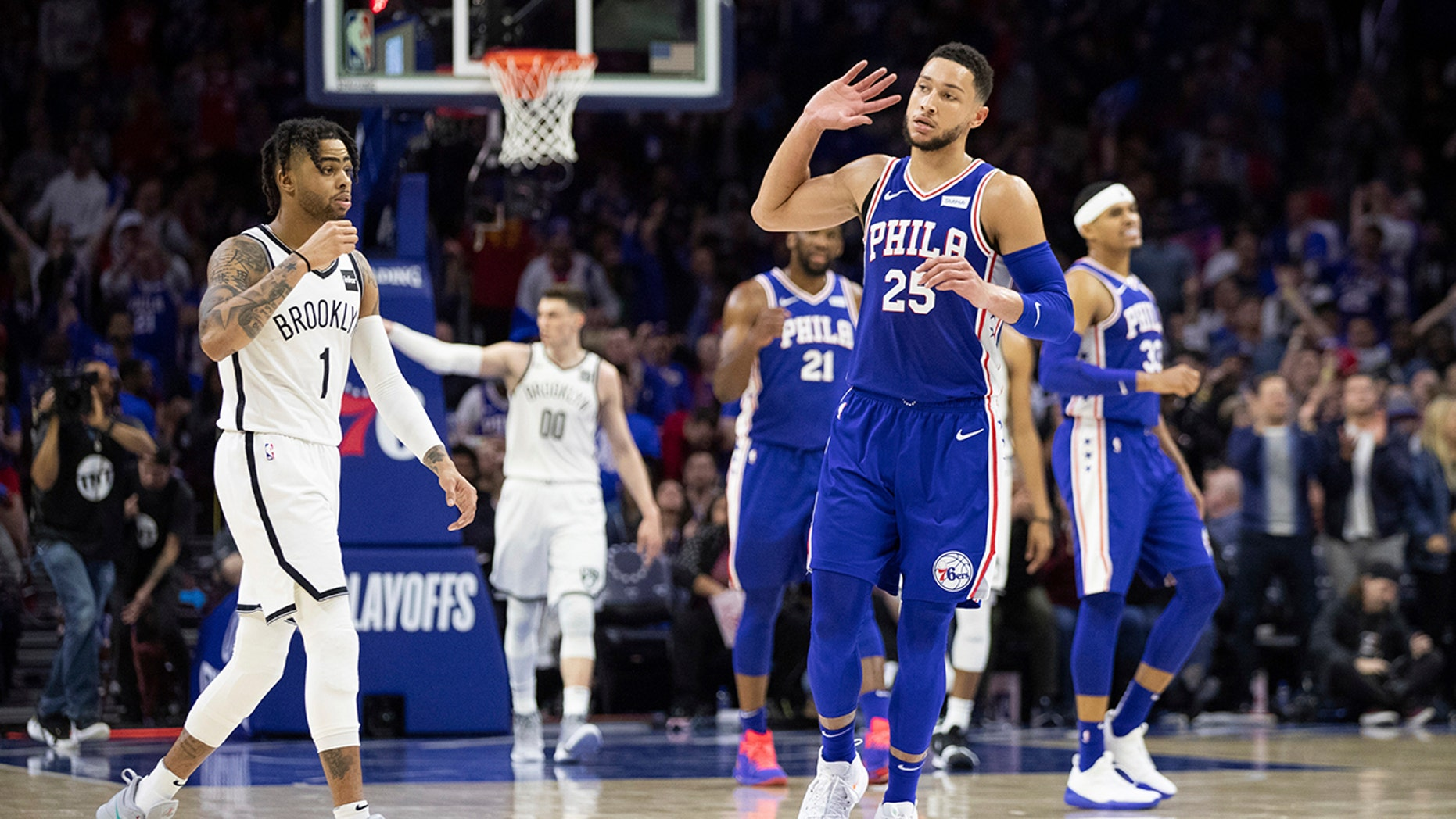 Philadelphia 76ers' Ben Simmons, right, of Australia, cups his hand to his ear after getting the ball from Brooklyn Nets' D'Angelo Russell, left, during the second half in Game 2 of a first-round NBA basketball playoff series, Monday, April 15, 2019, in Philadelphia. (AP Photo/Chris Szagola)
