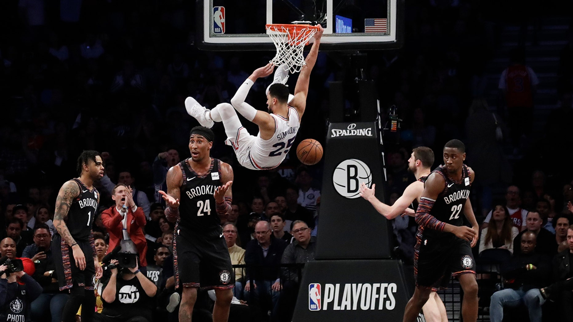 Brooklyn Nets' Rondae Hollis-Jefferson (24), Caris LeVert (22) and D'Angelo Russell (1) react to a dunk by Philadelphia 76ers' Ben Simmons (25) during the second half in Game 3 of a first-round NBA basketball playoff series Thursday, April 18, 2019, in New York. The 76ers won 131-115. (AP Photo/Frank Franklin II)