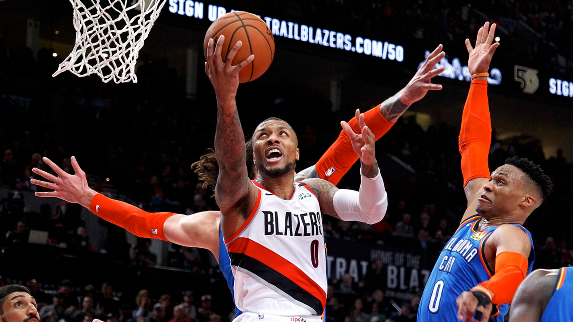 Portland Trail Blazers ensure Damian Lillard, center, shoots as Oklahoma City Thunder ensure Russell Westbrook, right, defends during a second half of Game 1 of a first-round NBA basketball playoff array in Portland, Ore., Sunday, Apr 14, 2019. (AP Photo/Steve Dipaola)