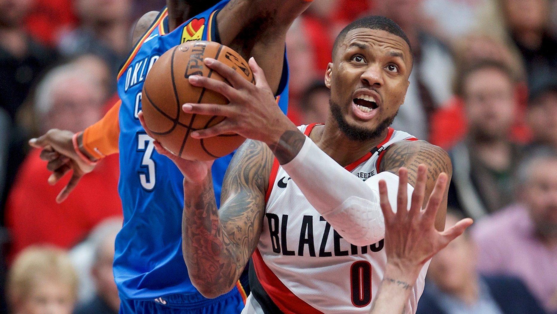Portland Trail Blazers guard Damian Lillard, right, shoots in front of Oklahoma City Thunder forward Nerlens Noel during the second half of Game 2 of an NBA basketball first-round playoff series Tuesday, April 16, 2019, in Portland, Ore. (AP Photo/Craig Mitchelldyer)