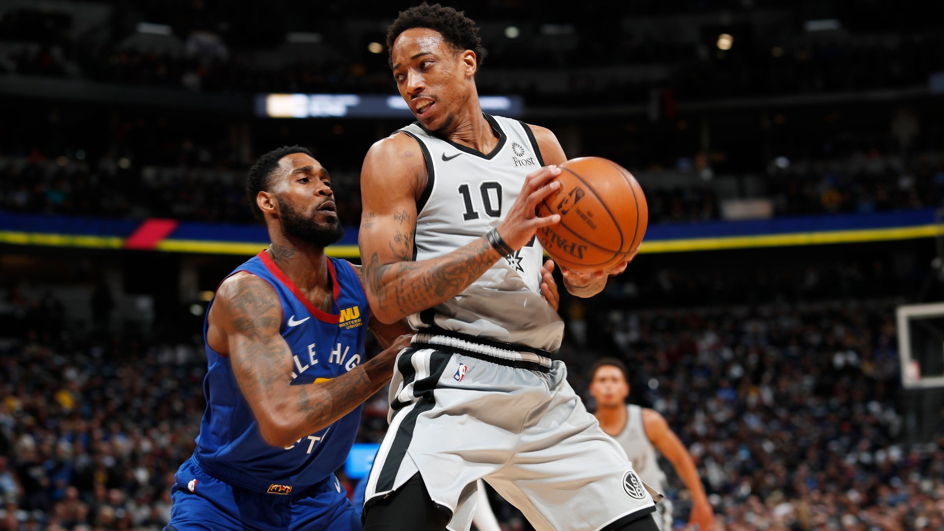 Denver Nuggets guard Will Barton, left, defends against San Antonio Spurs guard DeMar DeRozan during the first half of Game 1 of an NBA first-round basketball playoff series Saturday, April 13, 2019, in Denver. (AP Photo/David Zalubowski)