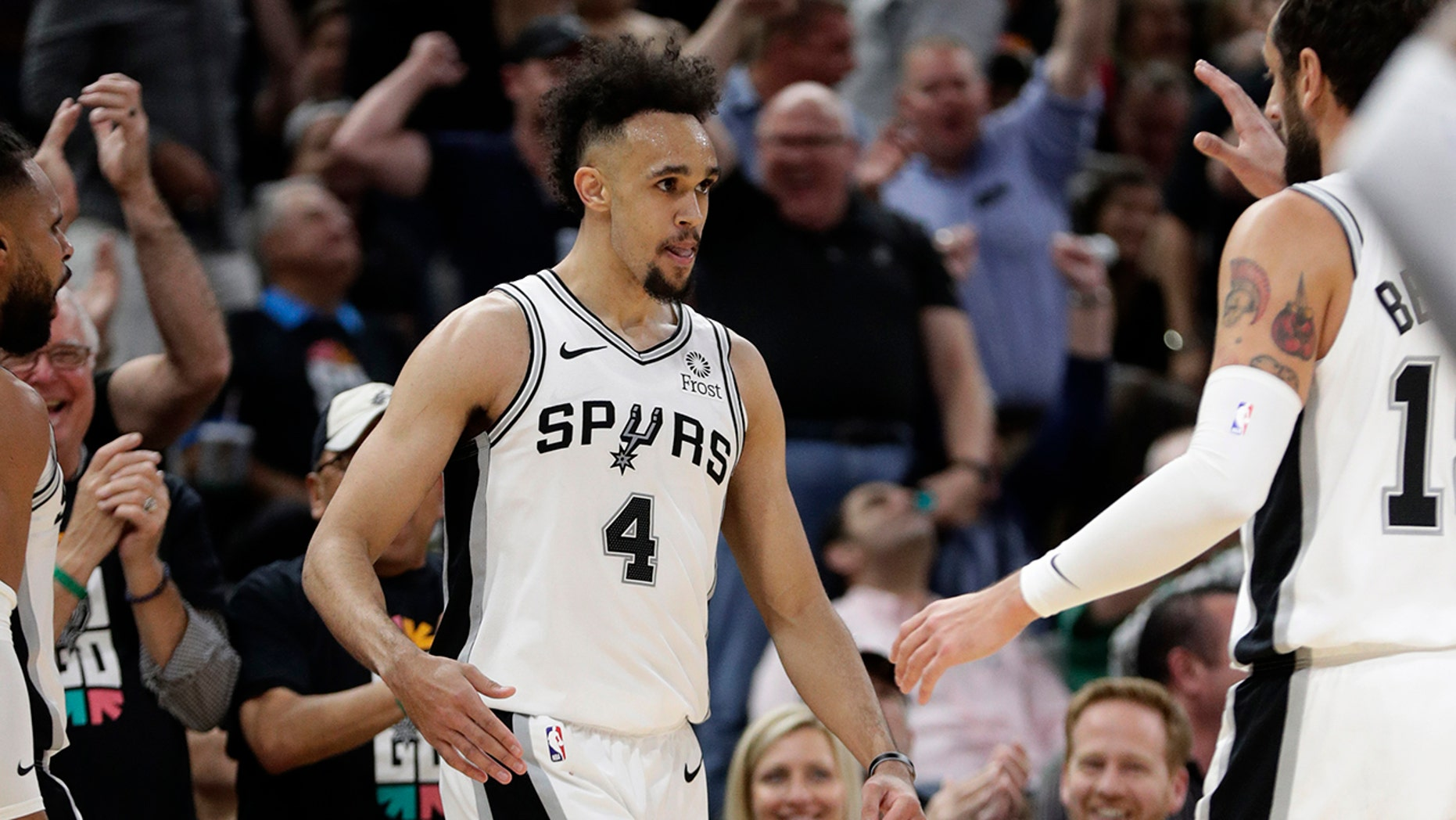 San Antonio Spurs ensure Derrick White (4) celebrates a measure opposite a Denver Nuggets with teammates during a initial half of Game 3 of an NBA basketball playoff array in San Antonio, Thursday, Apr 18, 2019. San Antonio won 118-108. (AP Photo/Eric Gay)