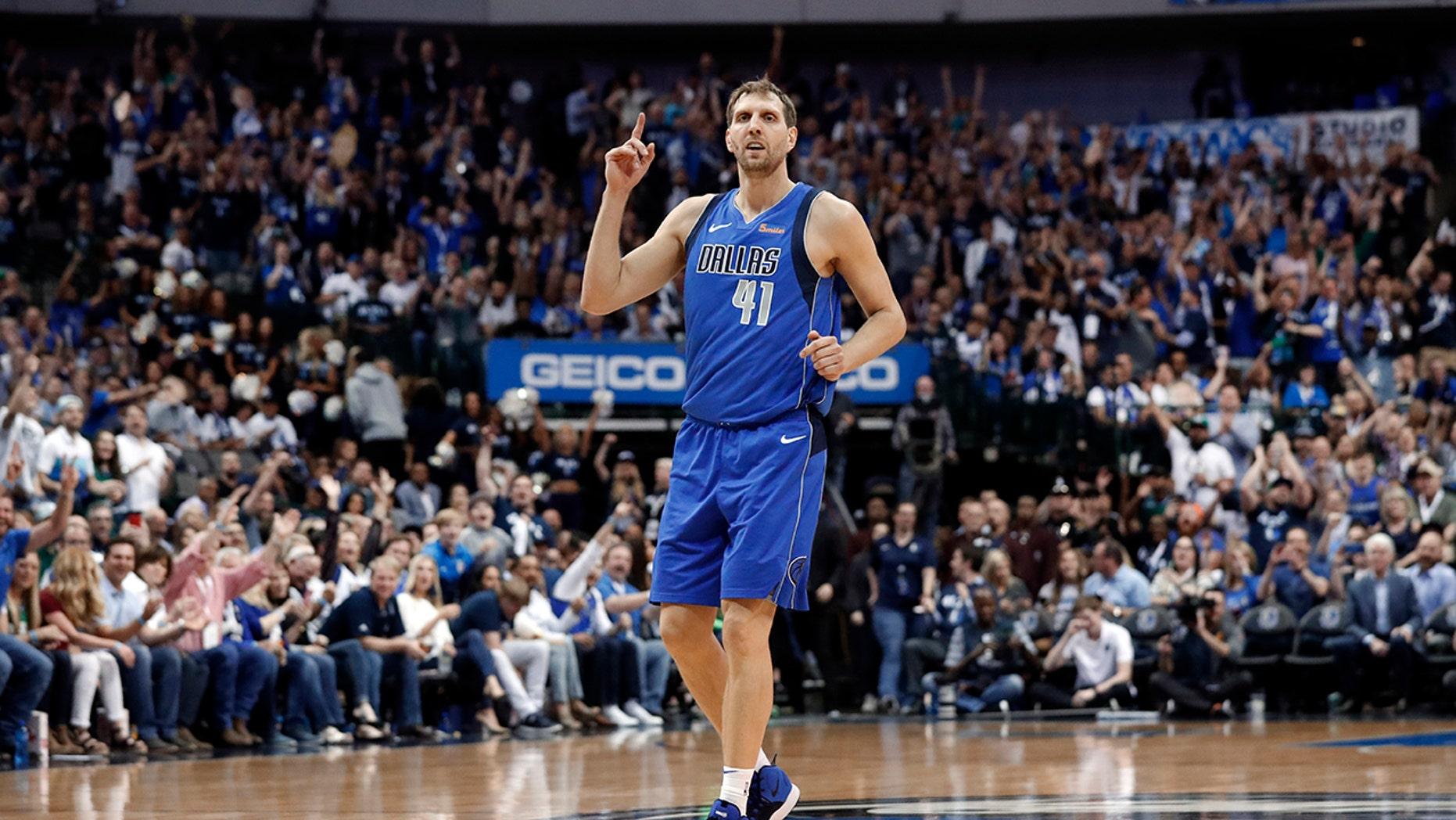 19f7f59f9 Dallas Mavericks  Dirk Nowitzki (41) celebrates sinking a 3-point basket  during