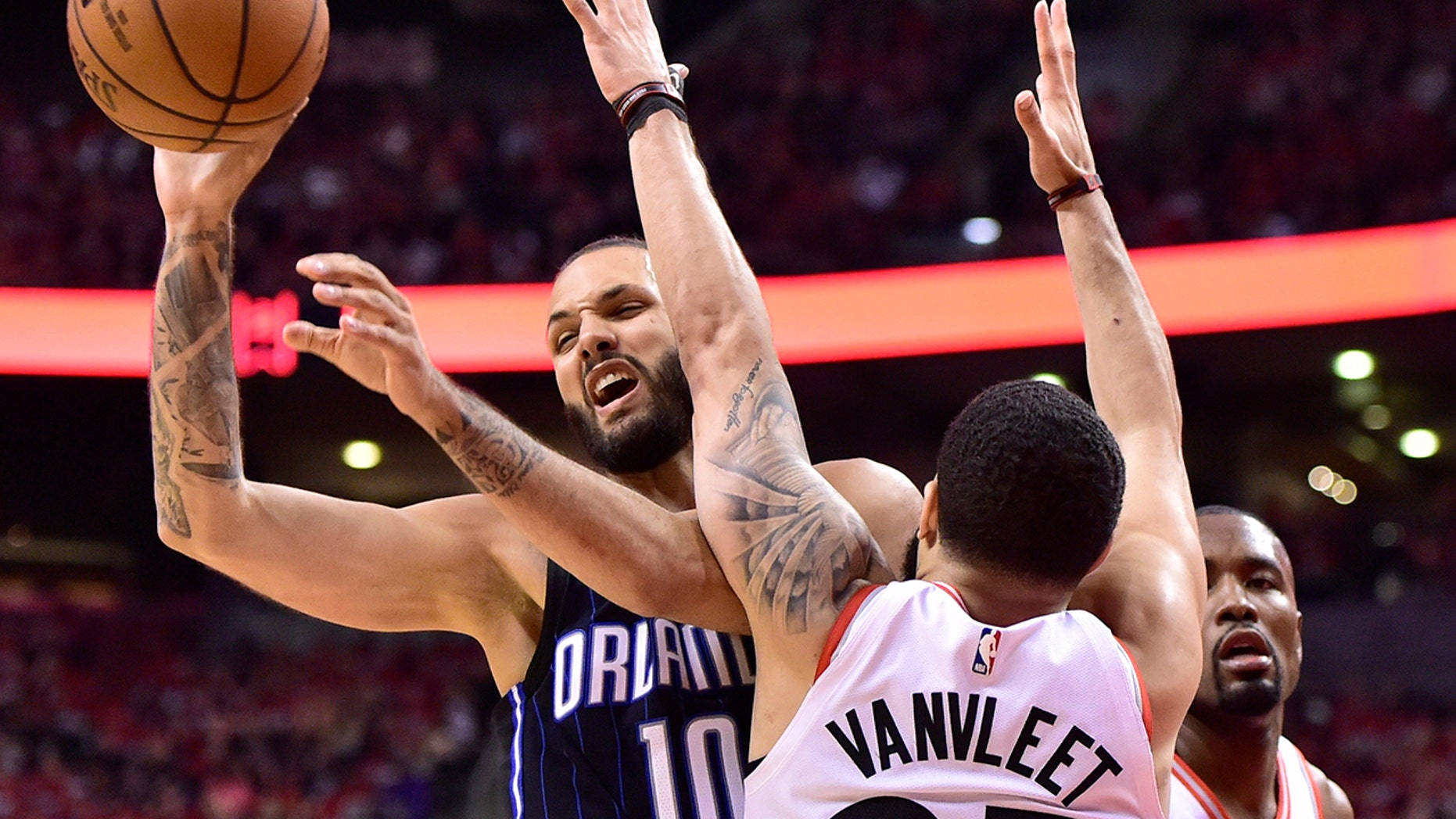 Orlando Magic guard Evan Fournier (10) controls the ball as Toronto Raptors guard Fred VanVleet (23) defends during the second half in Game 1 of a first-round NBA basketball playoff series in Toronto, Saturday, April 13, 2019. (Frank Gunn/The Canadian Press via AP)