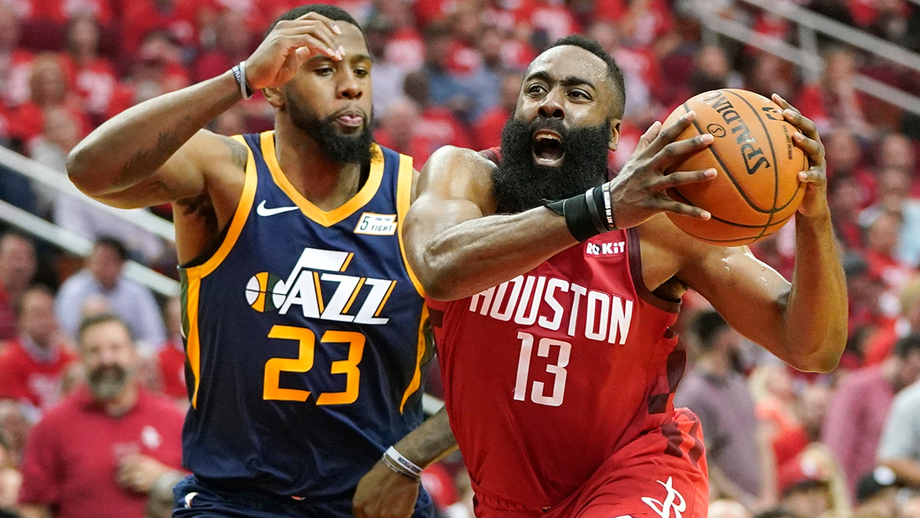 Houston Rockets ensure James Harden (13) drives opposite Utah Jazz brazen Royce O'Neale (23) during a initial half of Game 2 of a first-round NBA basketball playoff array in Houston, Wednesday, Apr 17, 2019. (AP Photo/David J. Phillip)