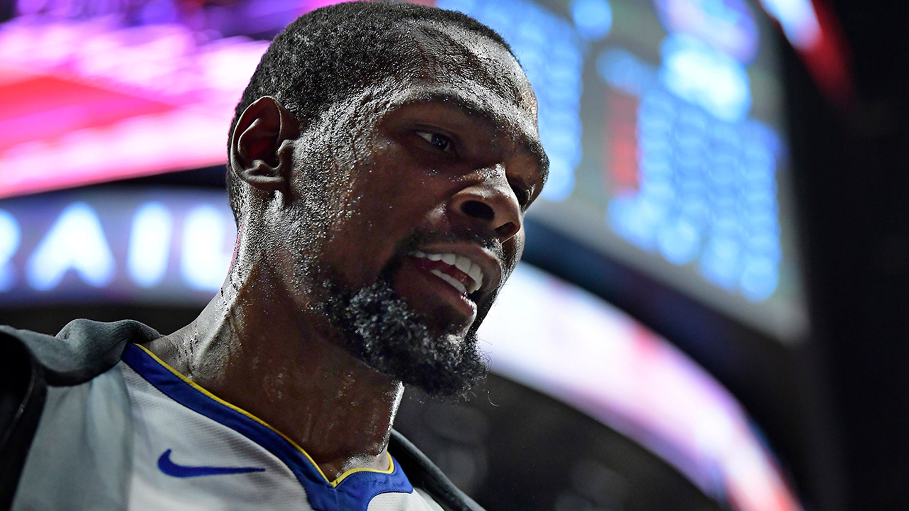 Golden State Warriors forward Kevin Durant paces around the bench during the first half in Game 3 of the team's first-round NBA basketball playoff series against the Los Angeles Clippers on Thursday, April 18, 2019, in Los Angeles. (AP Photo/Mark J. Terrill)