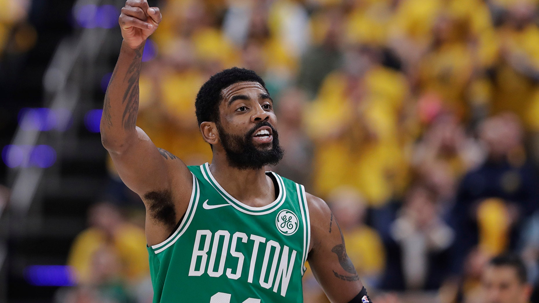 Boston Celtics guard Kyrie Irving gestures during the first half of Game 3 of the team's NBA basketball first-round playoff series against the Indiana Pacers, Friday, April 19, 2019, in Indianapolis. (AP Photo/Darron Cummings)