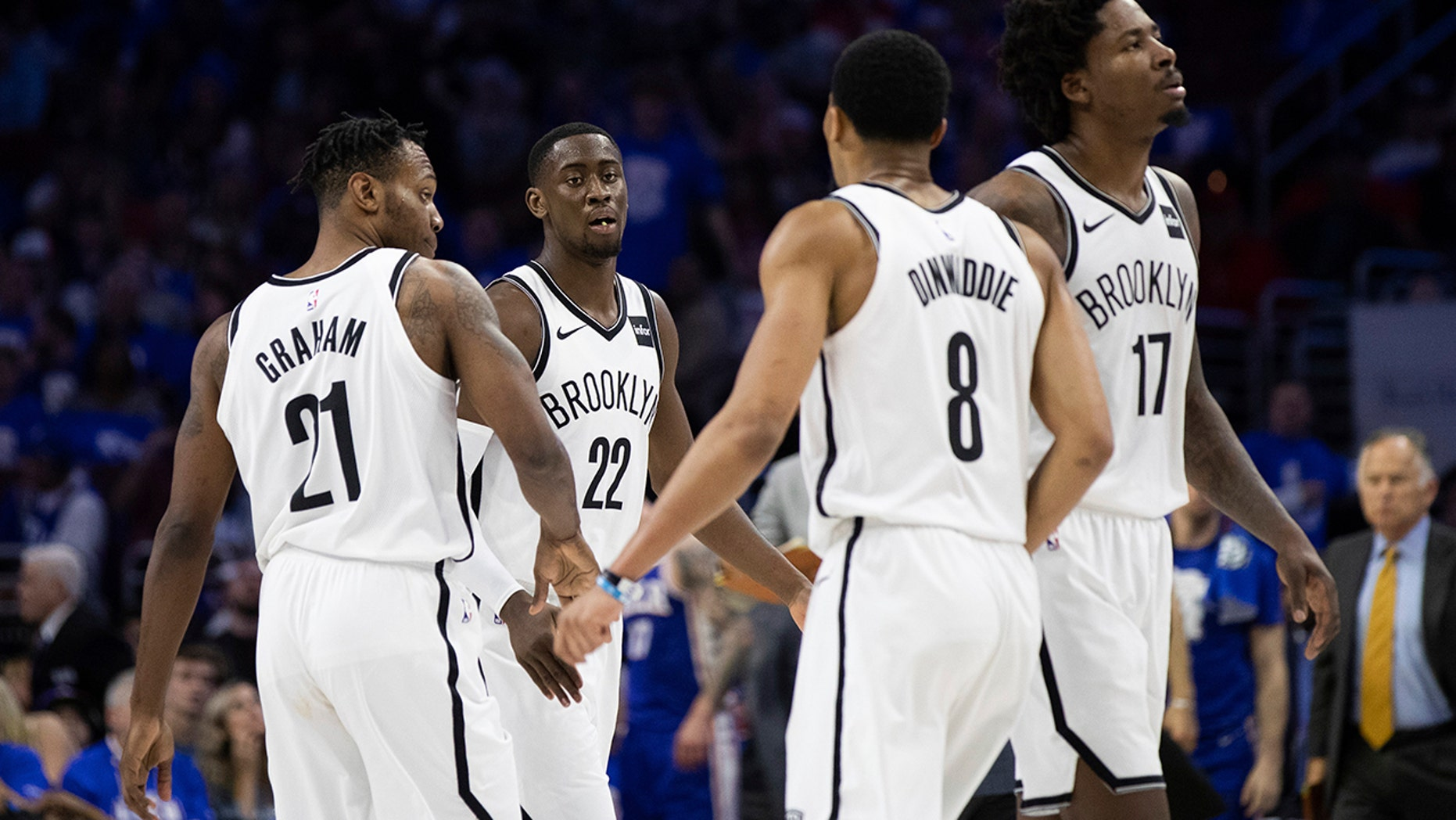 Brooklyn Nets' Caris LeVert, center left, celebrates with his teammates during the second half in Game 1 of a first-round NBA basketball playoff series against the Philadelphia 76ers, Saturday, April 13, 2019, in Philadelphia. The Nets won 111-102. (AP Photo/Chris Szagola)