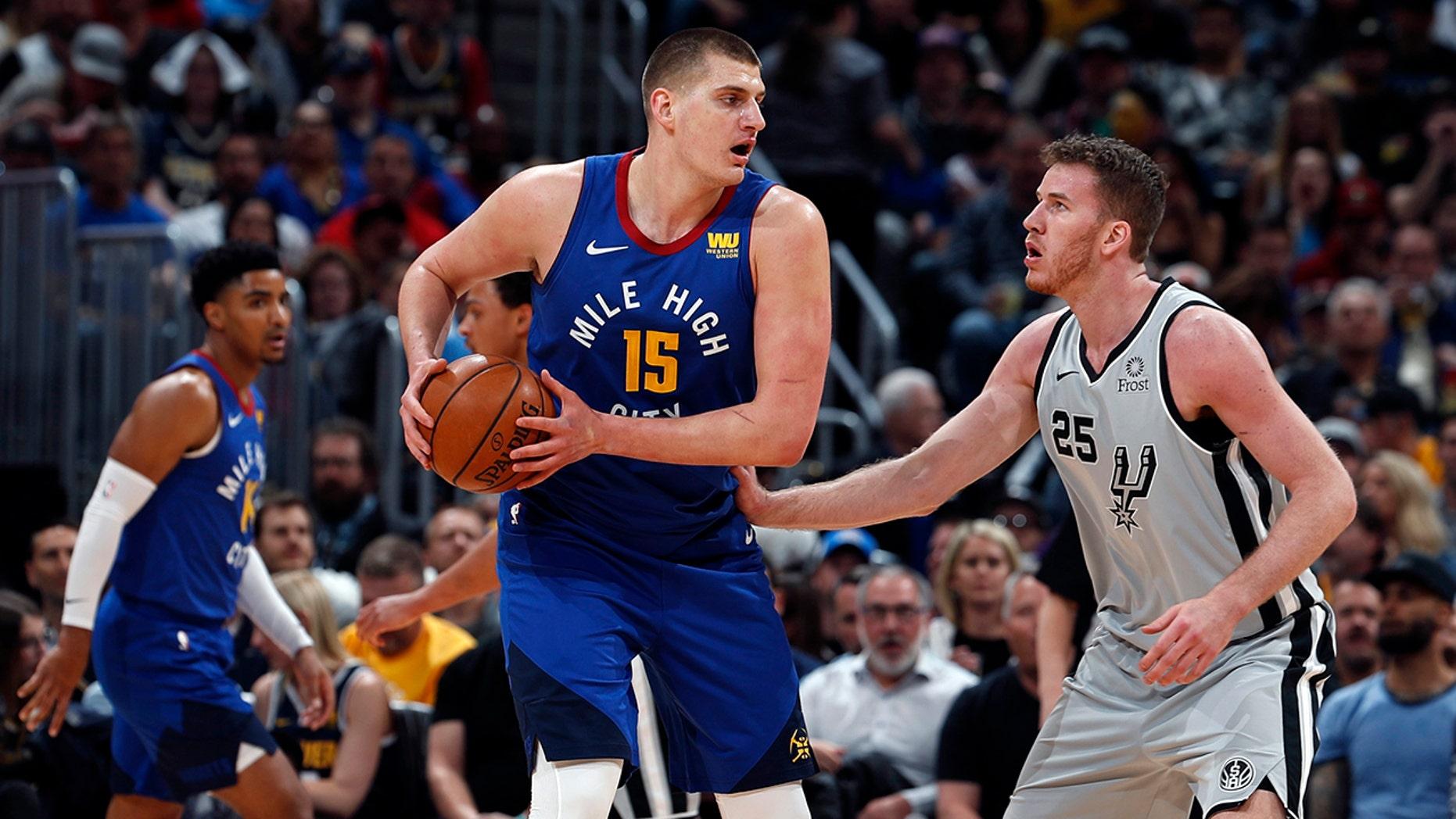 df24cd800c2 Denver Nuggets center Nikola Jokic (15) is pressured by San Antonio Spurs  center Jakob