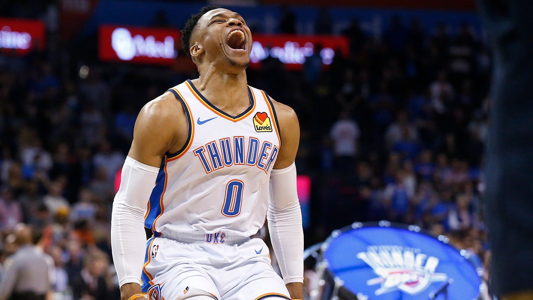 Oklahoma City Thunder guard Russell Westbrook (0) runs out and roars to the crowd before an NBA basketball game against the Los Angeles Lakers Tuesday, April 2, 2019, in Oklahoma City.