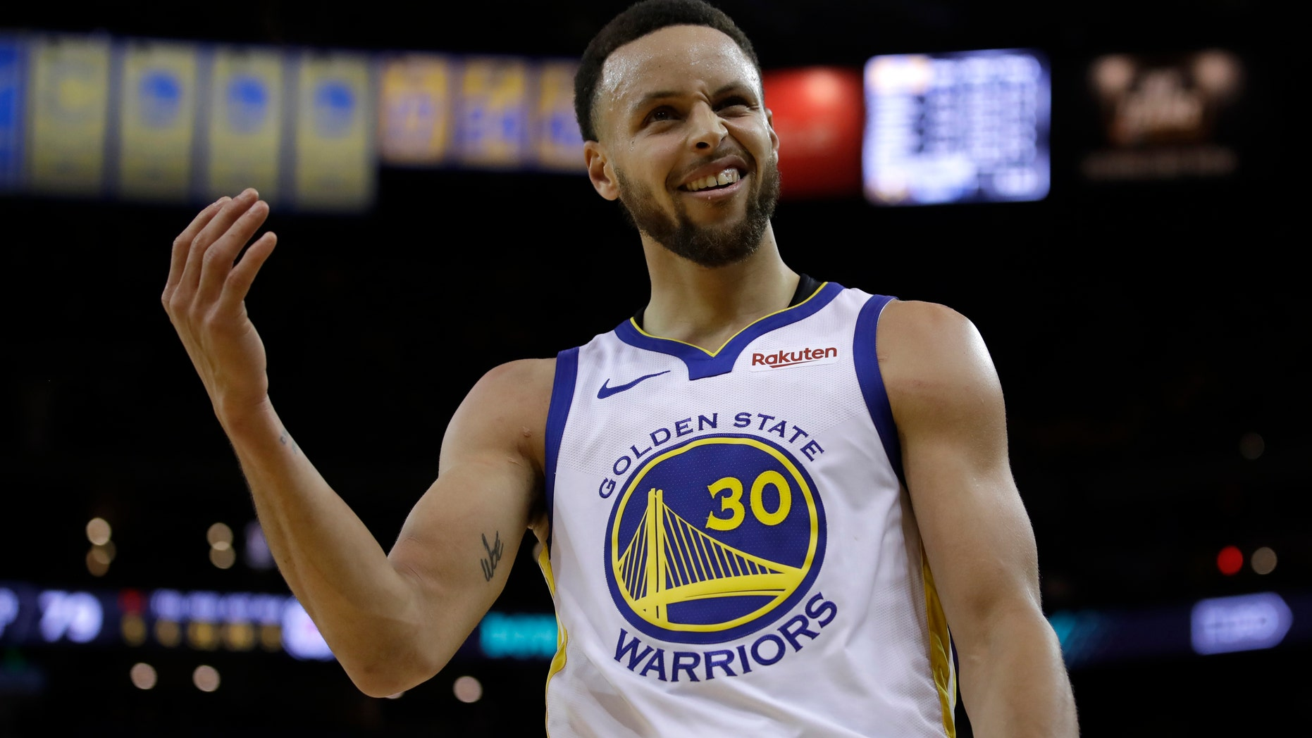 Golden State Warriors' Stephen Curry gestures to fans during the second half in Game 1 of a first-round NBA basketball playoff series against the Los Angeles Clippers, Saturday, April 13, 2019, in Oakland, Calif. (AP Photo/Ben Margot)