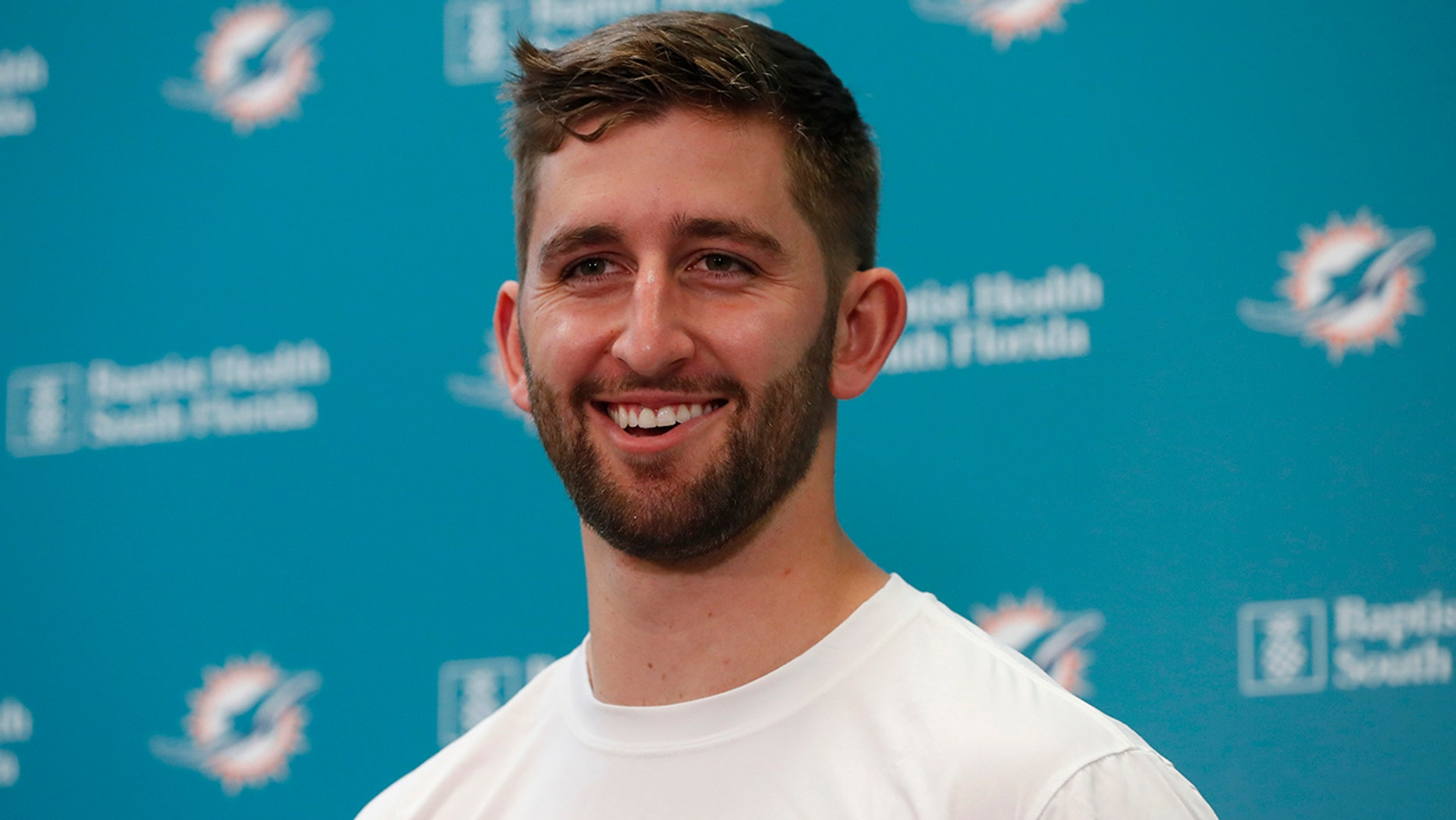 Miami Dolphins NFL football quarterback Josh Rosen smiles as he speaks during a news conference, Monday, April 29, 2019, at the Dolphins training facility in Davie, Fla. The Dolphins traded a 2019 second-round draft pick and a 2020 fifth-round selection to Arizona for Rosen. (AP Photo/Wilfredo Lee)