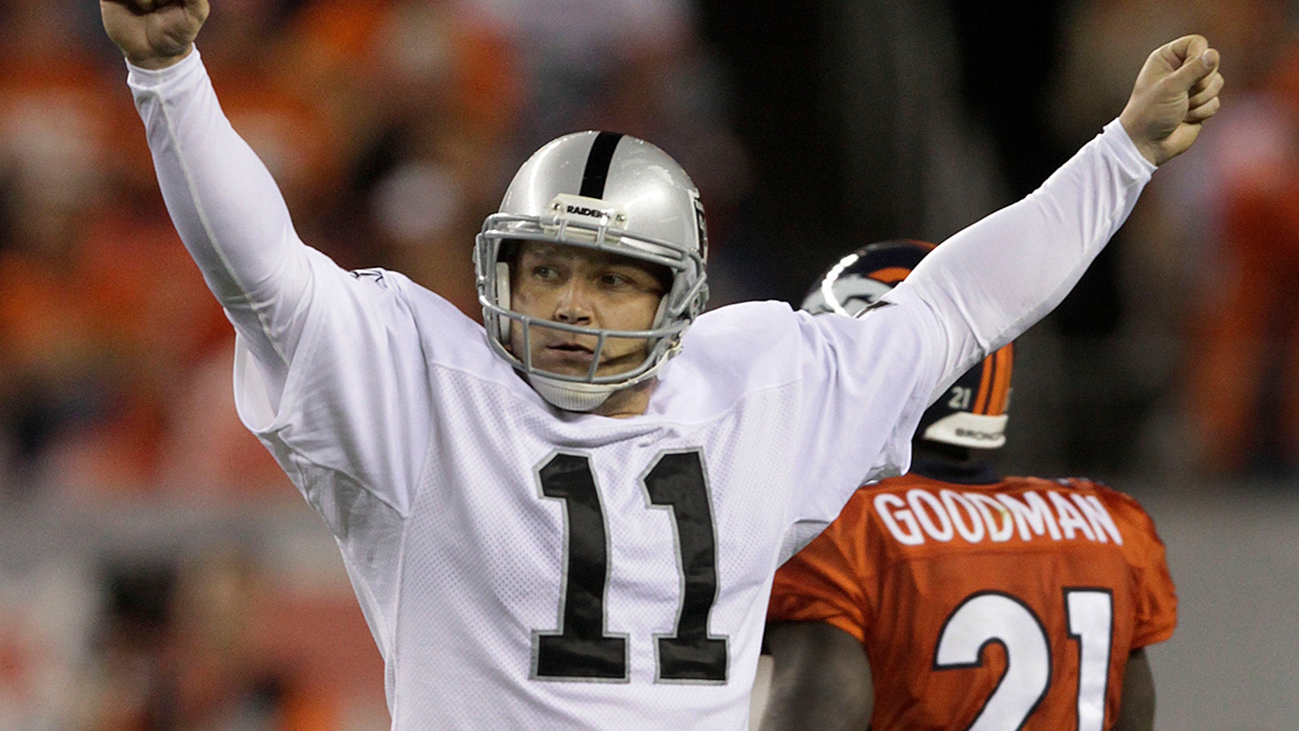 FILE - In this Sept. 12, 2011, file photo, Oakland Raiders kicker Sebastian Janikowski (11) reacts after kicking a 63-yard field goal against the Denver Broncos in the second quarter of an NFL football game, in Denver. (AP Photo/Joe Mahoney, File)