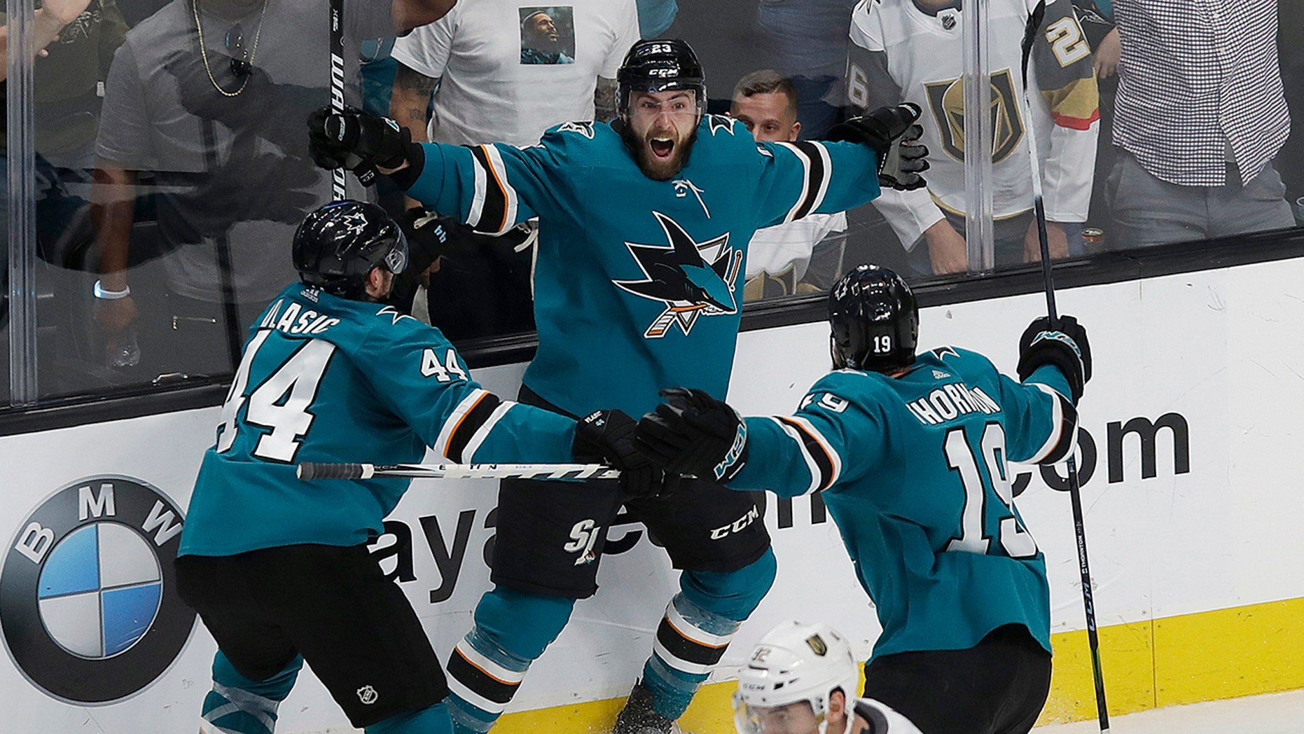 San Jose Sharks right wing Barclay Goodrow, center, celebrates with defenseman Marc-Edouard Vlasic (44) and center Joe Thornton (19) after scoring the winning goal against the Vegas Golden Knights during overtime of Game 7 of an NHL hockey first-round playoff series in San Jose, Calif., Tuesday, April 23, 2019. The Sharks won 5-4 in overtime. (AP Photo/Jeff Chiu)