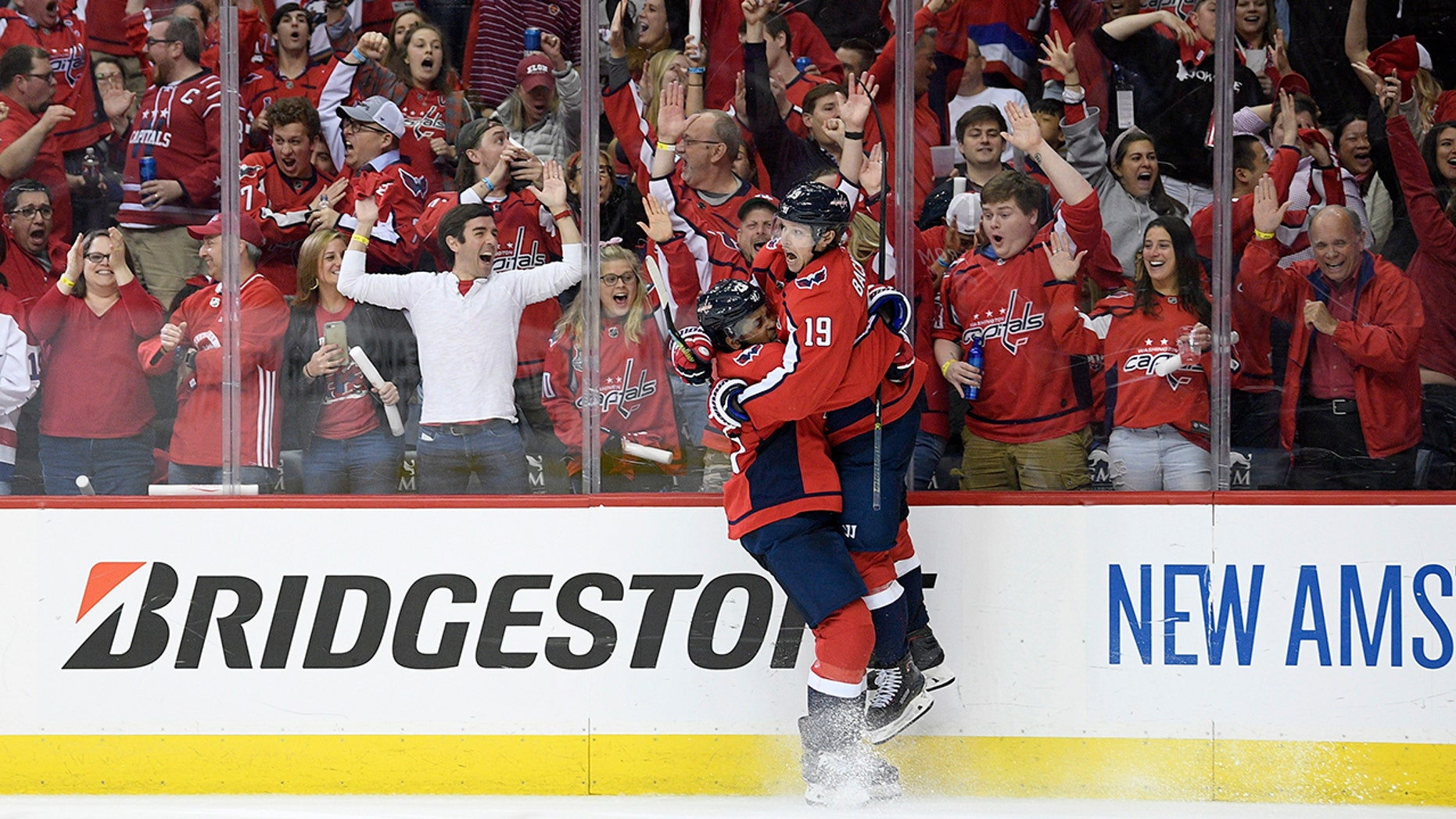 Washington Capitals center Nicklas Backstrom (19), of Sweden, celebrates his goal with right wing Devante Smith-Pelly, left, during the second period of Game 5 of an NHL hockey first-round playoff series against the Carolina Hurricanes, Saturday, April 20, 2019, in Washington. (AP Photo/Nick Wass)