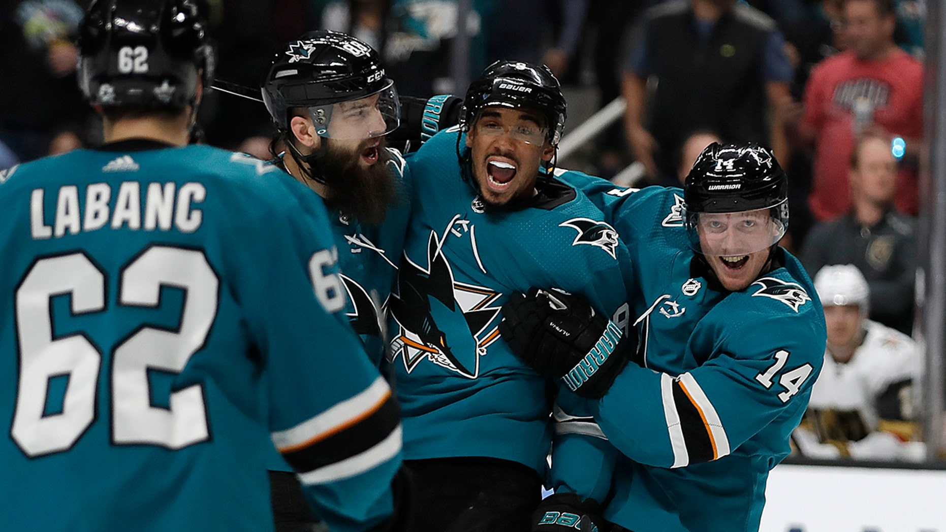 From left, San Jose Sharks' Kevin Labanc (62), Brent Burns, Evander Kane, and Gustav Nyquist (14) celebrate a goal by Joe Pavelski, not seen, against the Vegas Golden Knights during the first period of Game 1 of an NHL hockey first-round playoff series Wednesday, April 10, 2019, in San Jose, Calif. (AP Photo/Ben Margot)