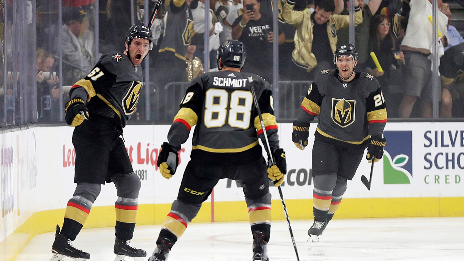 Vegas Golden Knights right wing Mark Stone, left, celebrates after scoring against the San Jose Sharks during the first period of Game 3 of an NHL first-round hockey playoff series game, Sunday, April 14, 2019, in Las Vegas. (AP Photo/Isaac Brekken)