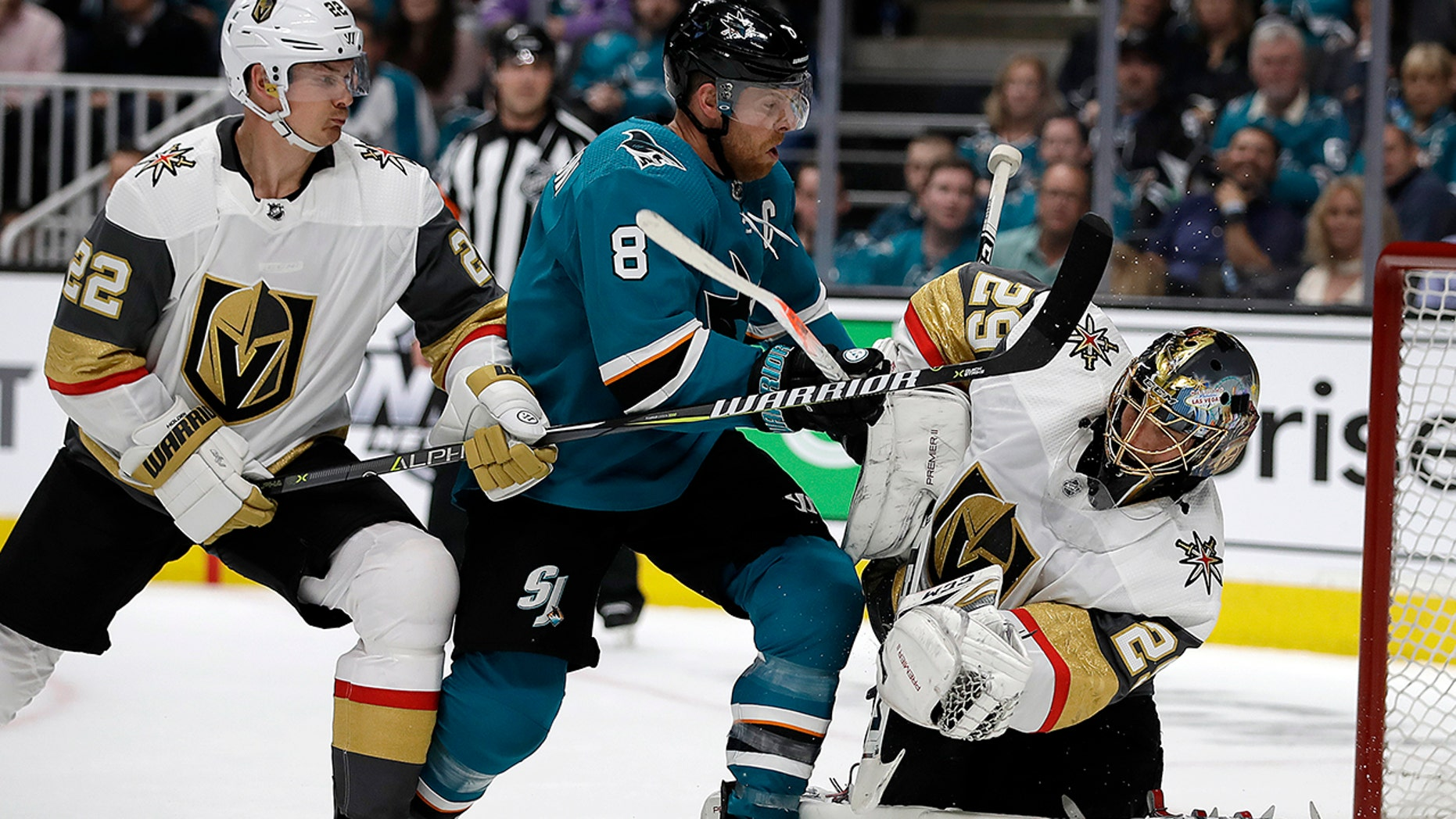 San Jose Sharks' Joe Pavelski (8) reacts after scoring a goal against Vegas Golden Knights goalie Marc-Andre Fleury, right, during the first period of Game 1 of an NHL hockey first-round playoff series Wednesday, April 10, 2019, in San Jose, Calif. At left is Golden Knights defenseman Nick Holden.