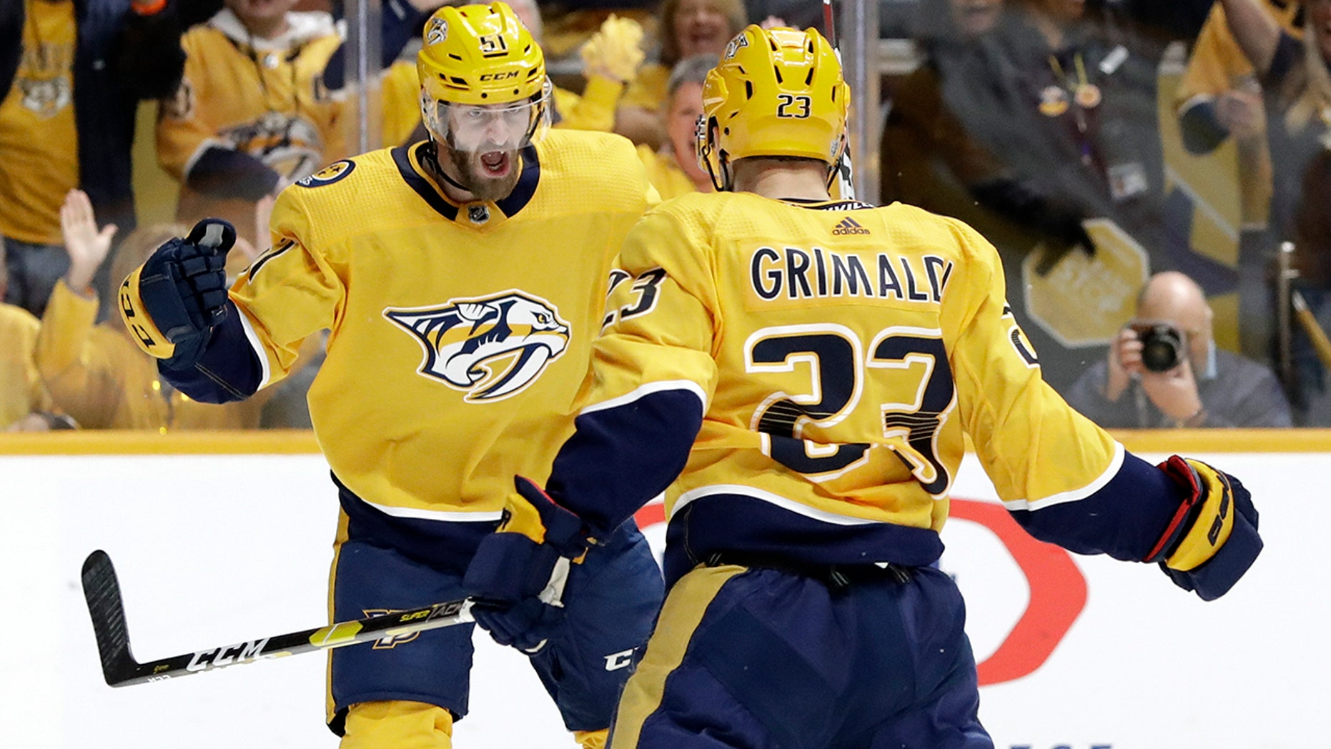 Nashville Predators center Rocco Grimaldi (23) celebrates with Austin Watson (51) after scoring a goal against the Dallas Stars during the second period in Game 2 of an NHL hockey first-round playoff series Saturday, April 13, 2019, in Nashville, Tenn. (AP Photo/Mark Humphrey)