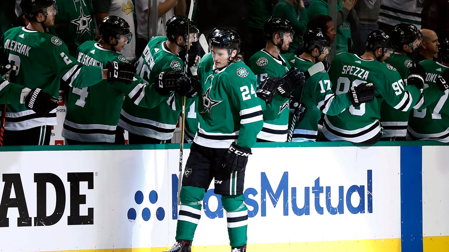 Dallas Stars' Roope Hintz (24) is congratulated by the bench after scoring against the Nashville Predators during the second period of Game 4 in an NHL hockey first-round playoff series in Dallas, Wednesday, April 17, 2019. (AP Photo/Tony Gutierrez)