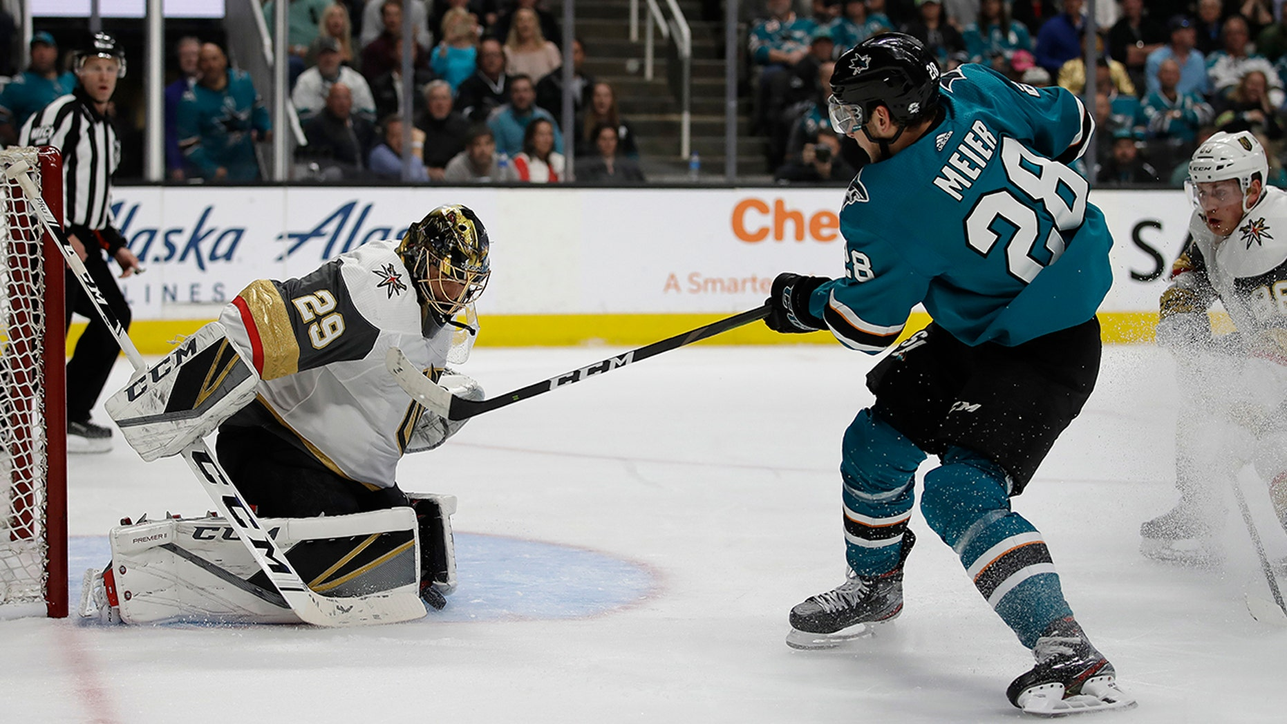 Vegas Golden Knights goalie Marc-Andre Fleury, left, blocks a shot from San Jose Sharks' Timo Meier (28) during the first period of Game 5 of an NHL hockey first-round playoff series Thursday, April 18, 2019, in San Jose, Calif. (AP Photo/Ben Margot)