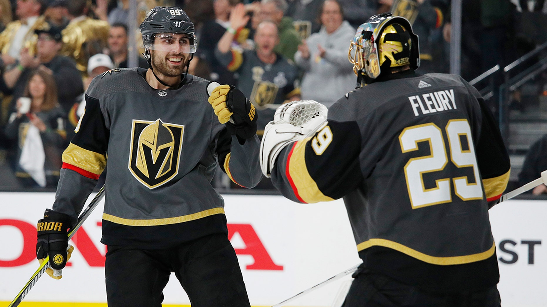 Vegas Golden Knights right wing Alex Tuch, left, celebrates with goalie Marc-Andre Fleury after scoring against the San Jose Sharks during the third period of Game 4 of a first-round NHL hockey playoff series Tuesday, April 16, 2019, in Las Vegas. (AP Photo/John Locher)