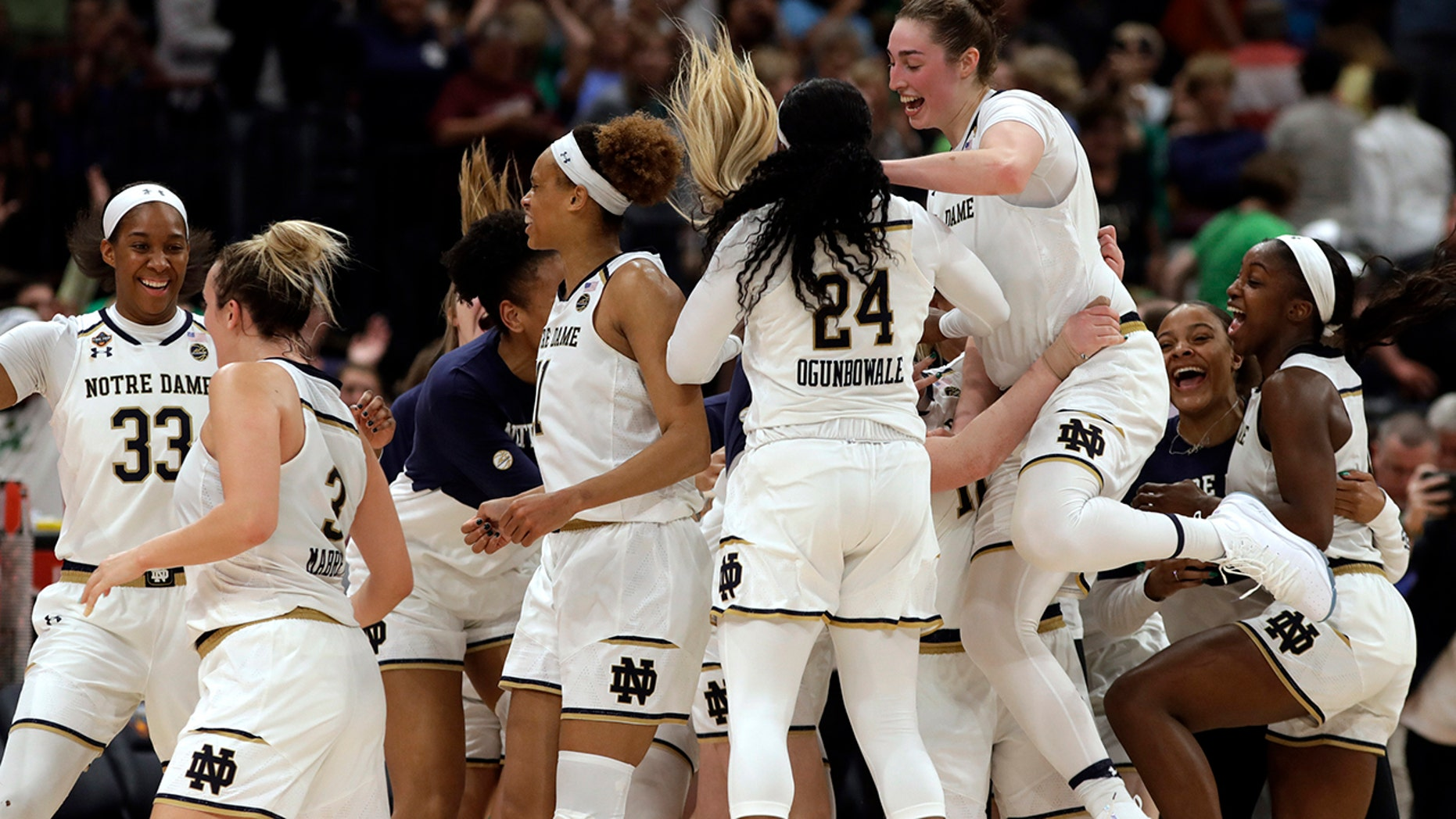 The Notre Dame team celebrates at the end of the team's 81-76 win over Connecticut during a Final Four semifinal of the NCAA women's college basketball tournament Friday, April 5, 2019, in Tampa, Fla.(Associated Press)