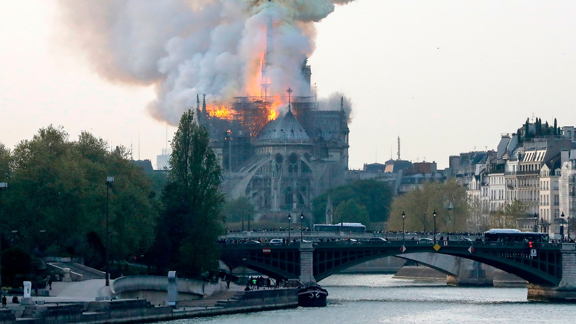 Smoke ascends as flames rise during a fire at the landmark Notre-Dame Cathedral in central Paris on April 15, 2019 afternoon, potentially involving renovation works being carried out at the site, the fire service said.
