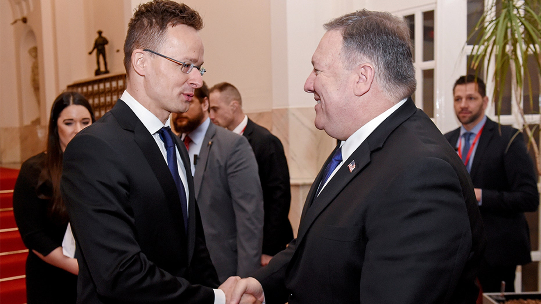 U.S. Secretary of State Mike Pompeo is welcomed by Hungary's Minister of Foreign Affairs and Trade Peter Szijjarto in the ministry building in Budapest, Hungary, February 11, 2019. (Attila Kisbenedek/Pool via Reuters)